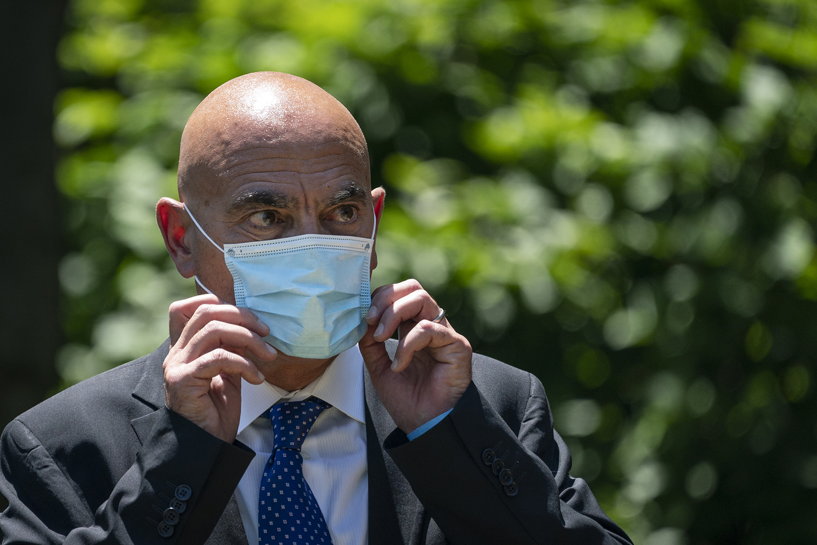 Moncef Slaoui listens as President Donald Trump delivers remarks about coronavirus vaccine development in the Rose Garden on May 15, in Washington.