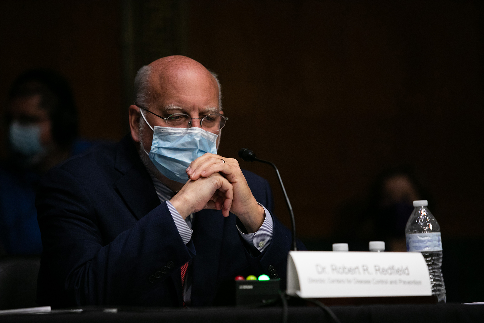 CDC Director Dr. Robert R. Redfield prepares to testify at a Senate Labor, Health and Human Services, Education and Related Agencies Subcommittee hearing on manufacturing a Coronavirus vaccine on Capitol Hill on July 2, in Washington.