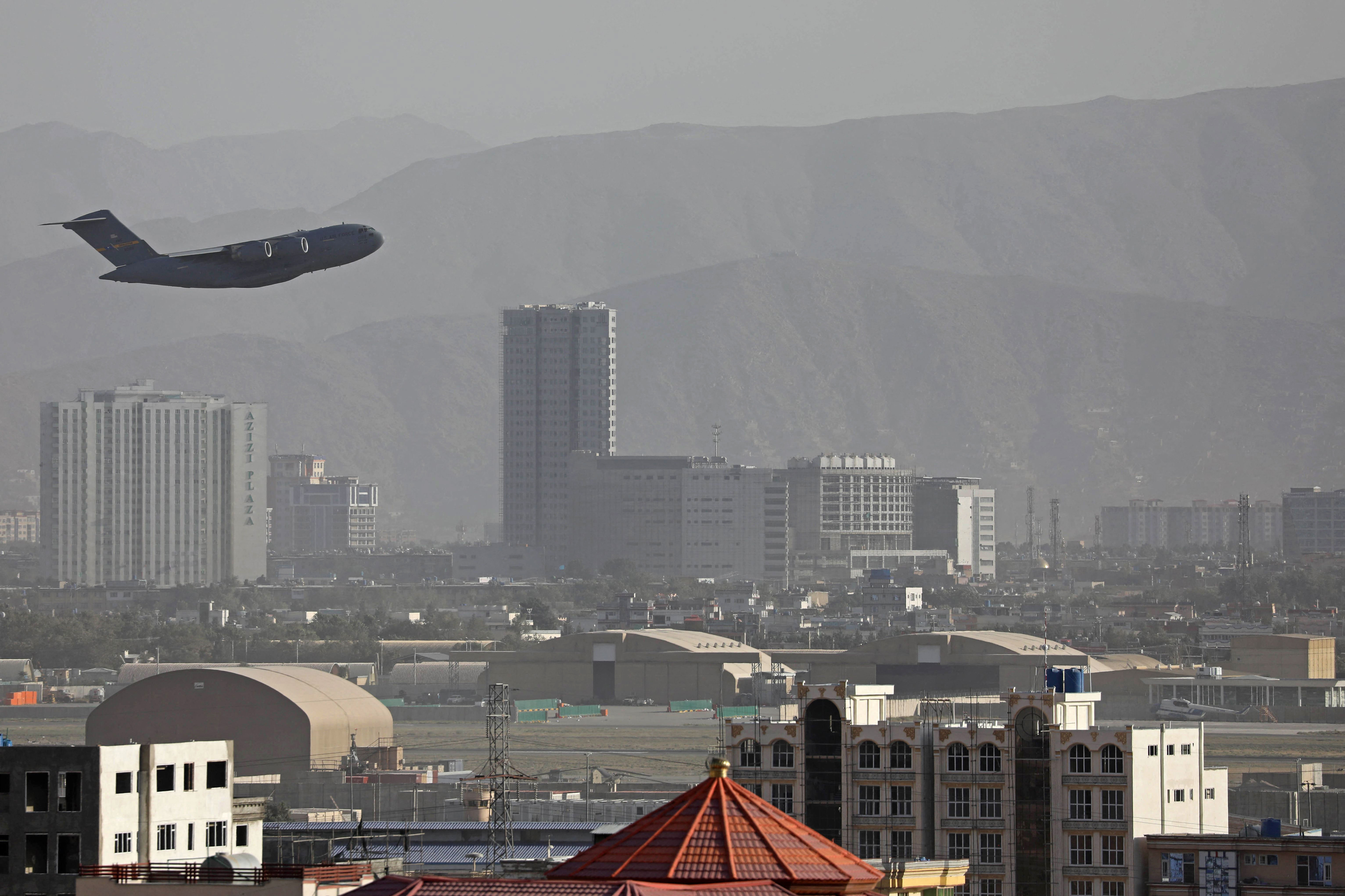 A US Air Force plane takes off from the military airport in Kabul, Afghanistan, on August 27, 2021.