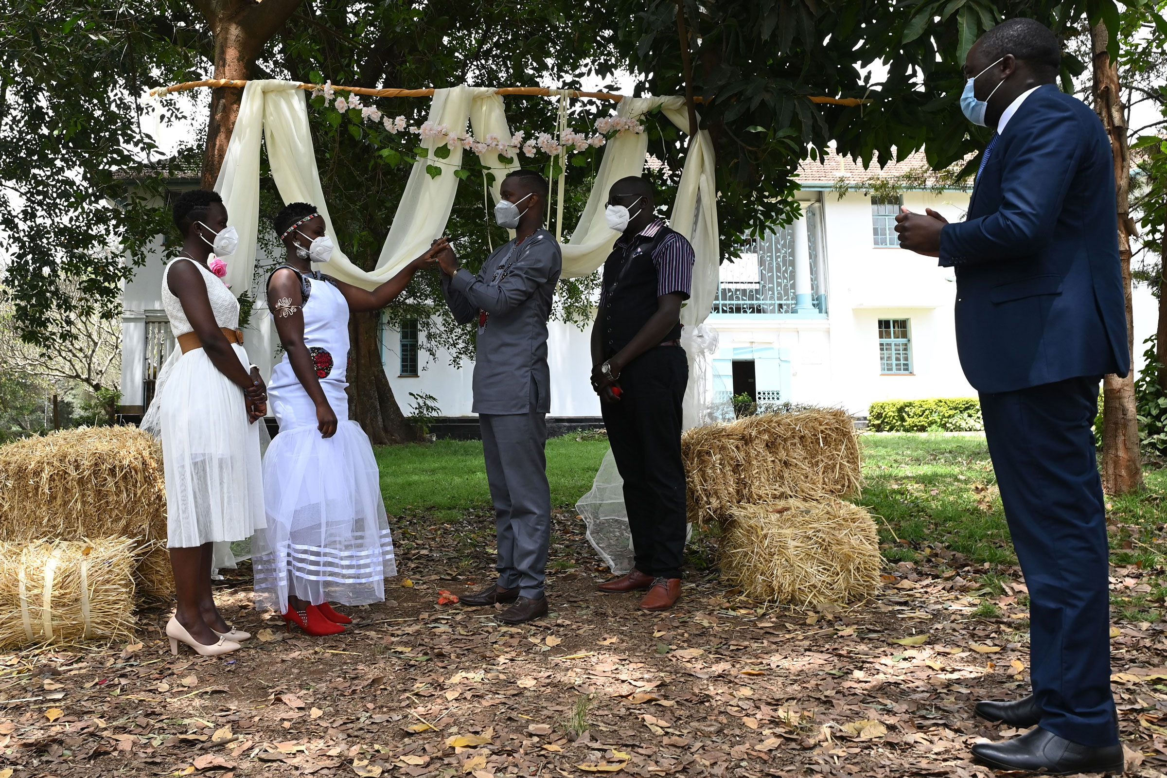 Charles Otieno and Jackline Adhiambo exchange rings during their wedding in Nairobi, Kenya, on Friday. The wedding, attended by just a few relatives, lasted for only 15 minutes because of coronavirus restrictions.