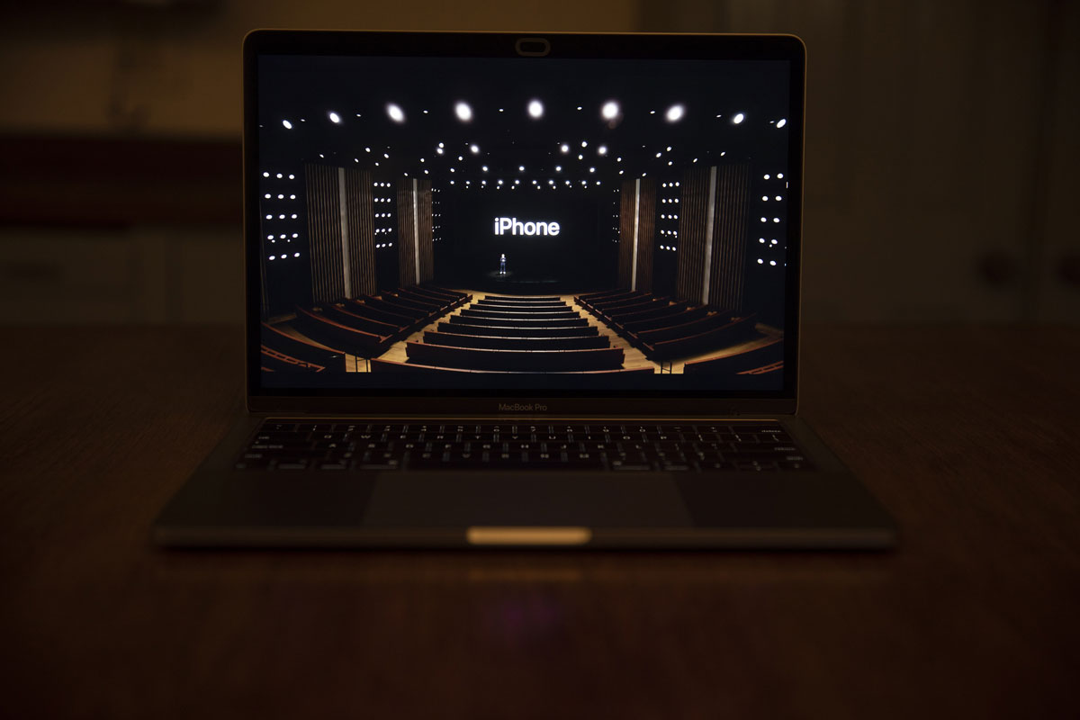 Tim Cook, CEO of Apple Inc., stands onstage during a virtual product launch seen on a laptop on October 13, 2020.