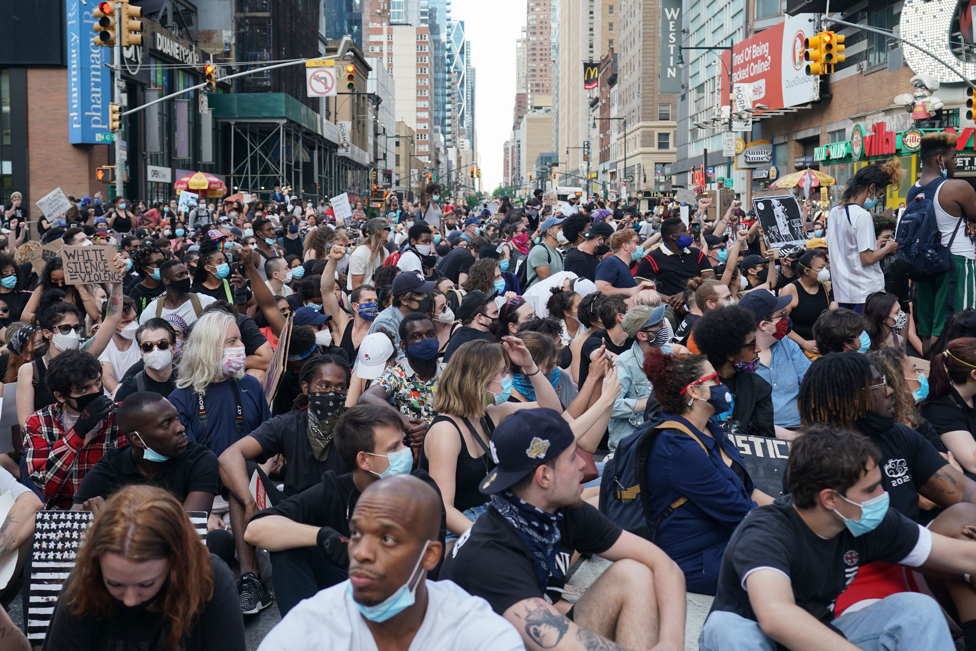 Protesters sit in the middle of the intersection of 42nd Street near Times Square on June 7 in New York.