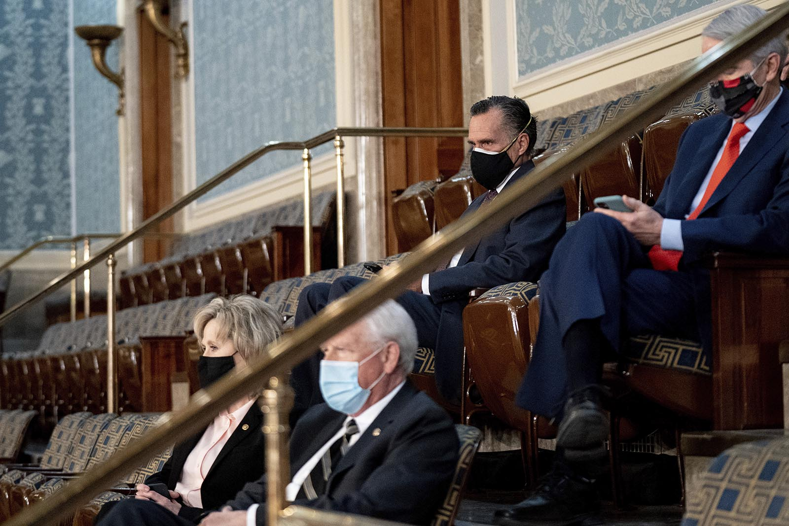Sen. Mitt Romney of Utah watches as a joint session of the House and Senate convenes to confirm the Electoral College votes cast in November's election, at the Capitol in Washington on Wednesday, January 6.