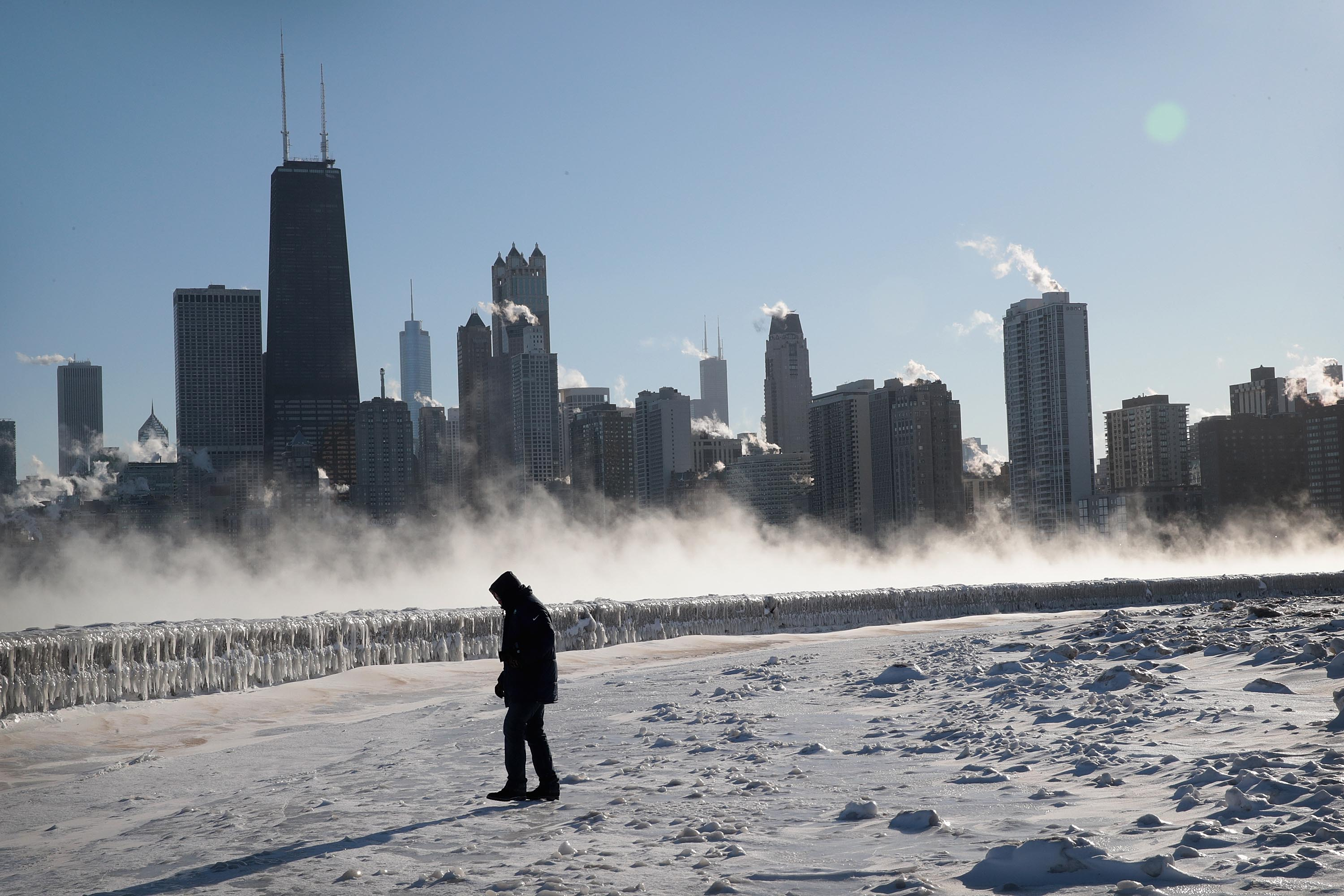 A man walks along the lakefront as temperatures hovered around -20 degrees on Wednesday
