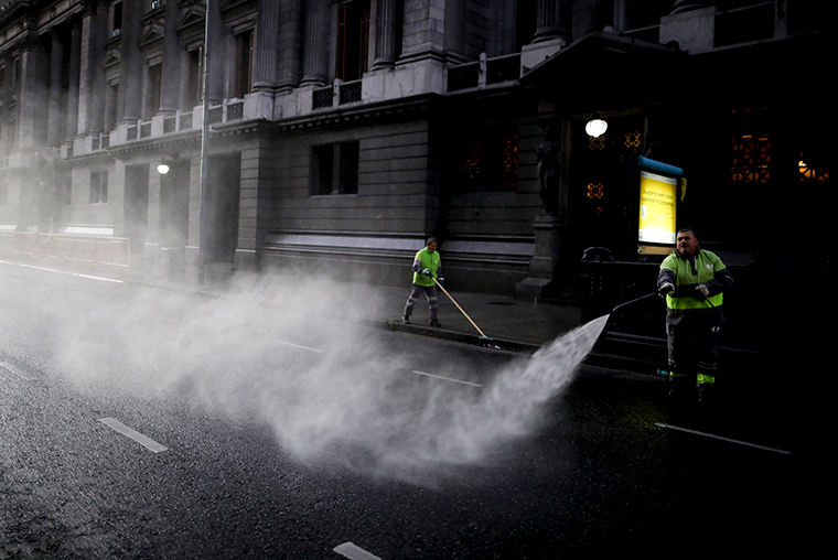 A worker disinfects the street outside Congress during a government-ordered lockdown t in Buenos Aires, Argentina, Wednesday, April 8.