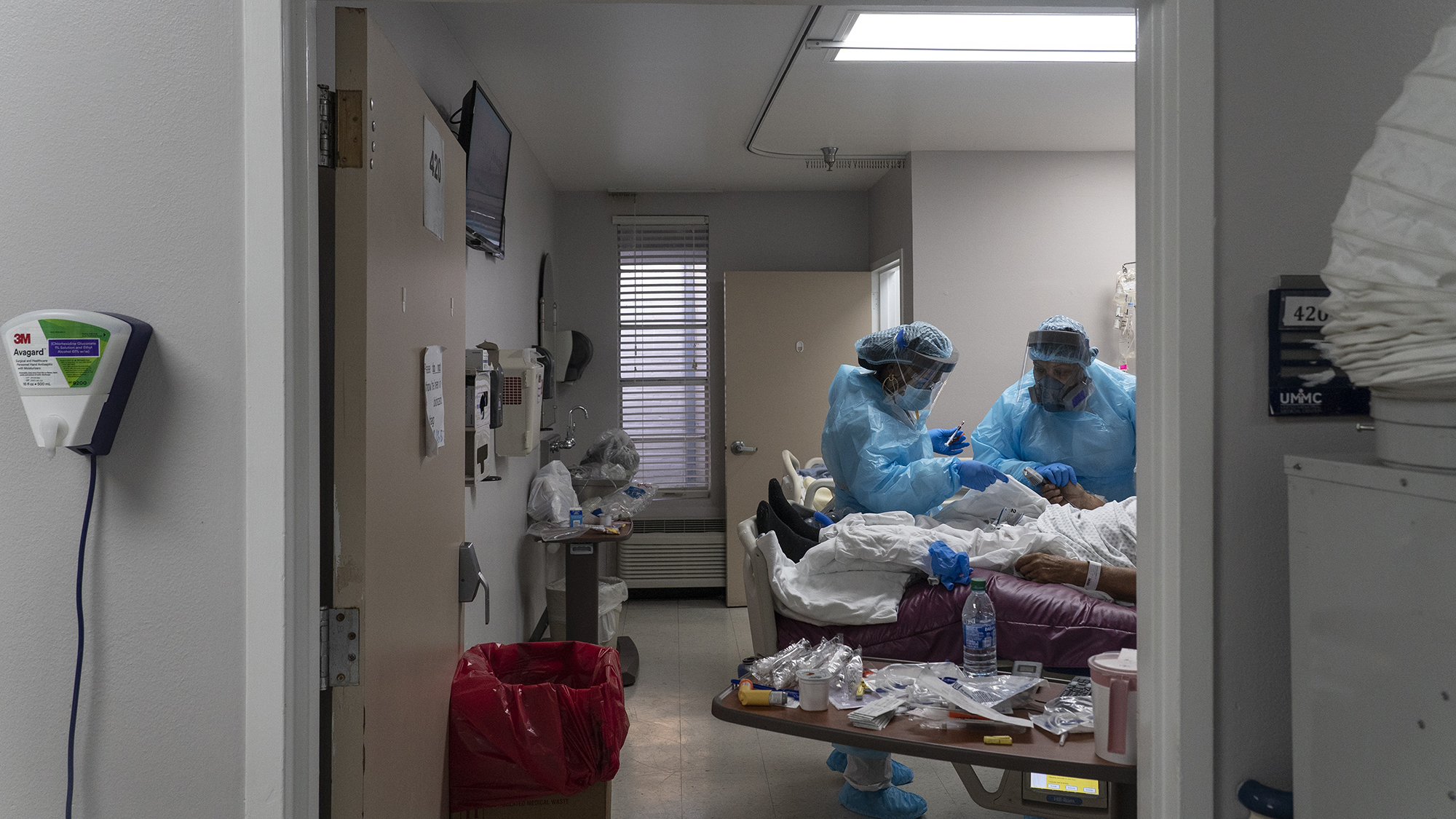 Medical staff members treat a patient suffering from the coronavirus disease in the Covid-19 intensive care unit at the United Memorial Medical Center on November 19 in Houston.
