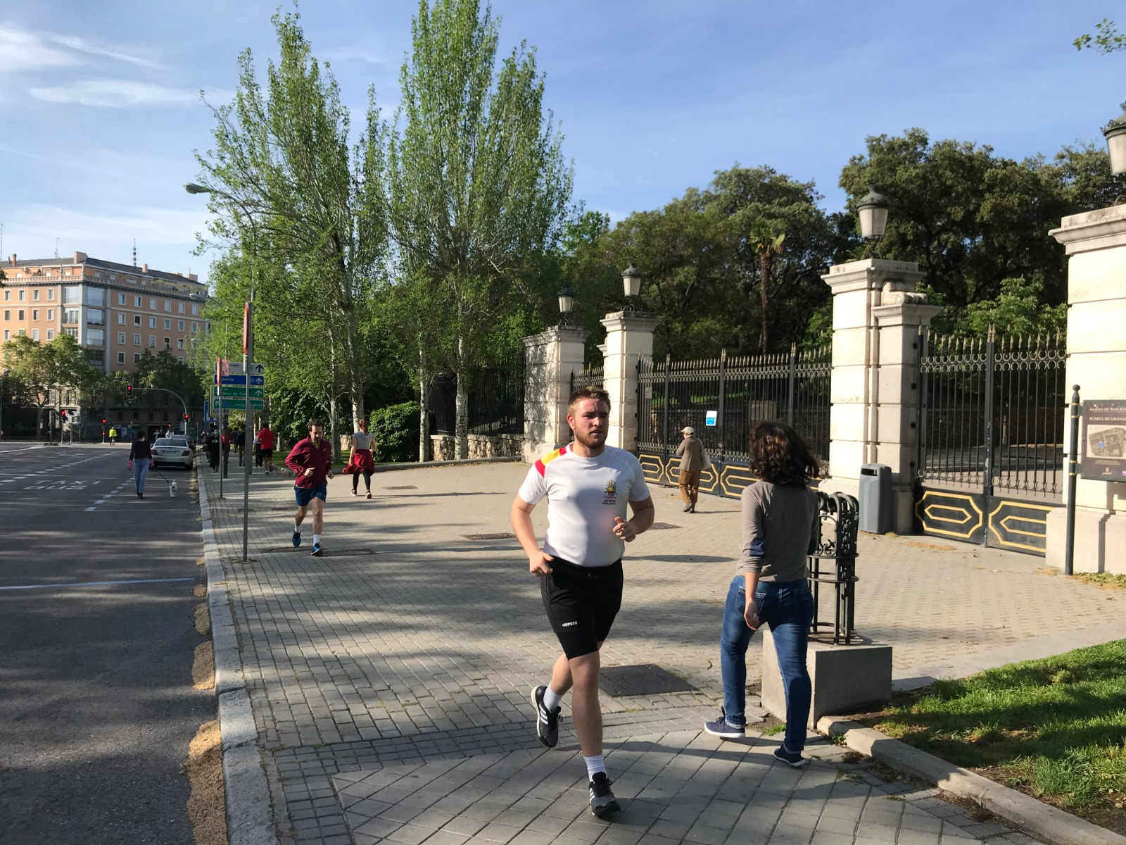 Runners outside Madrid's Retiro Park, which remains closed, on Saturday morning.