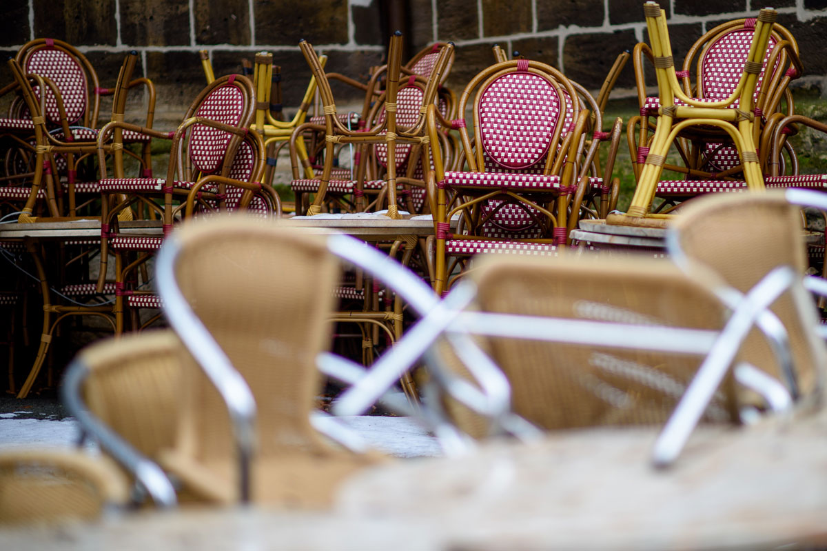 Chairs of a coffee shop are stacked in the empty town of Quedlinburg, Germany on February 3.