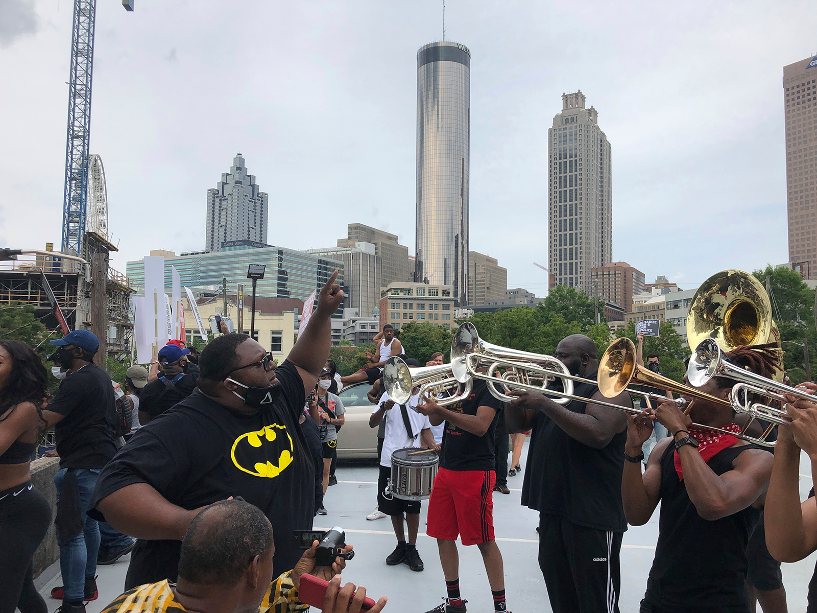 Zachary Nealy leads a brass band calling itself the Protesters Mass Band atop a parking garage in downtown Atlanta, on Saturday, June 6.