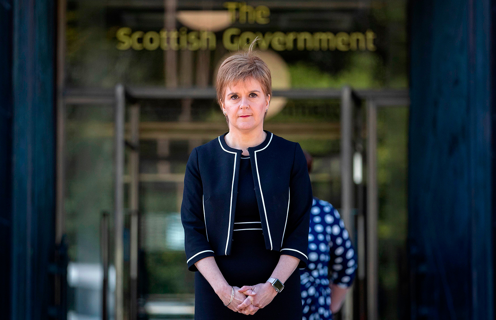 Scotland's First Minister Nicola Sturgeon pauses for a minute's silence to honour UK key workers, including Britain's NHS (National Health Service) staff, health and social care workers, who have died during the coronavirus outbreak, outside At Andrew's House in Edinburgh on Tuesday, April 28.