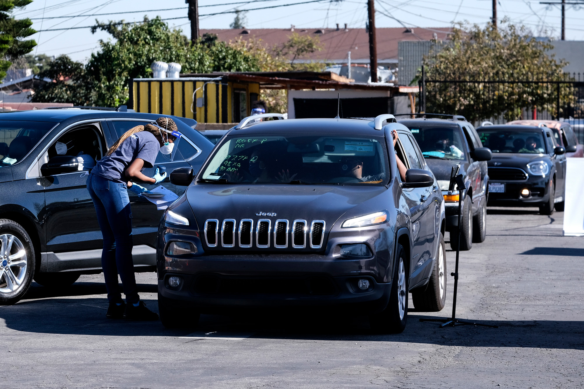 Motorists wait in line for a rapid COVID-19 antibody and PCR test at the Southside Church of Christ in Los Angeles on January 18.
