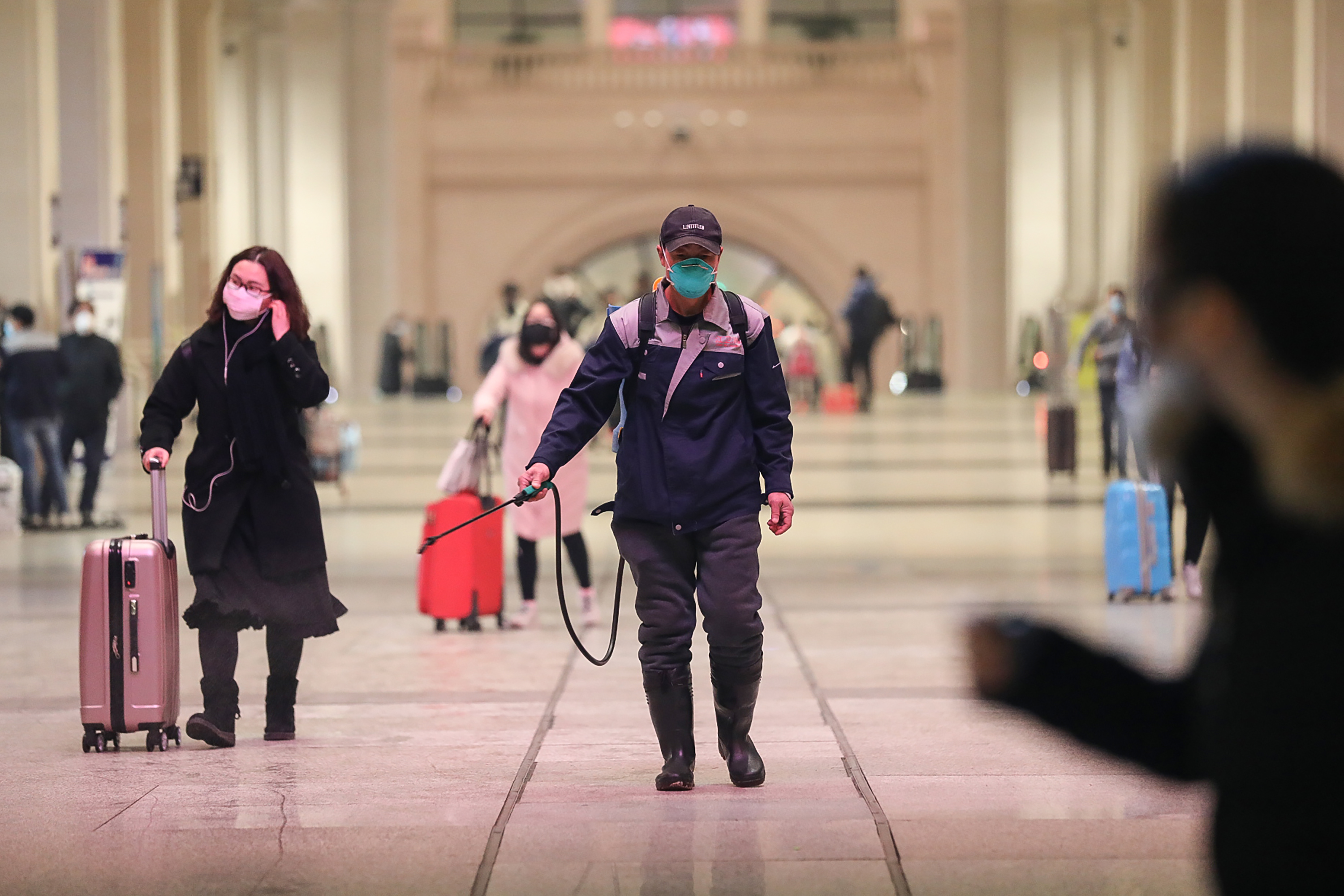 A staff member disinfects surfaces at the Hankou Railway Station in Wuhan, in China's central Hubei province early on Wednesday.