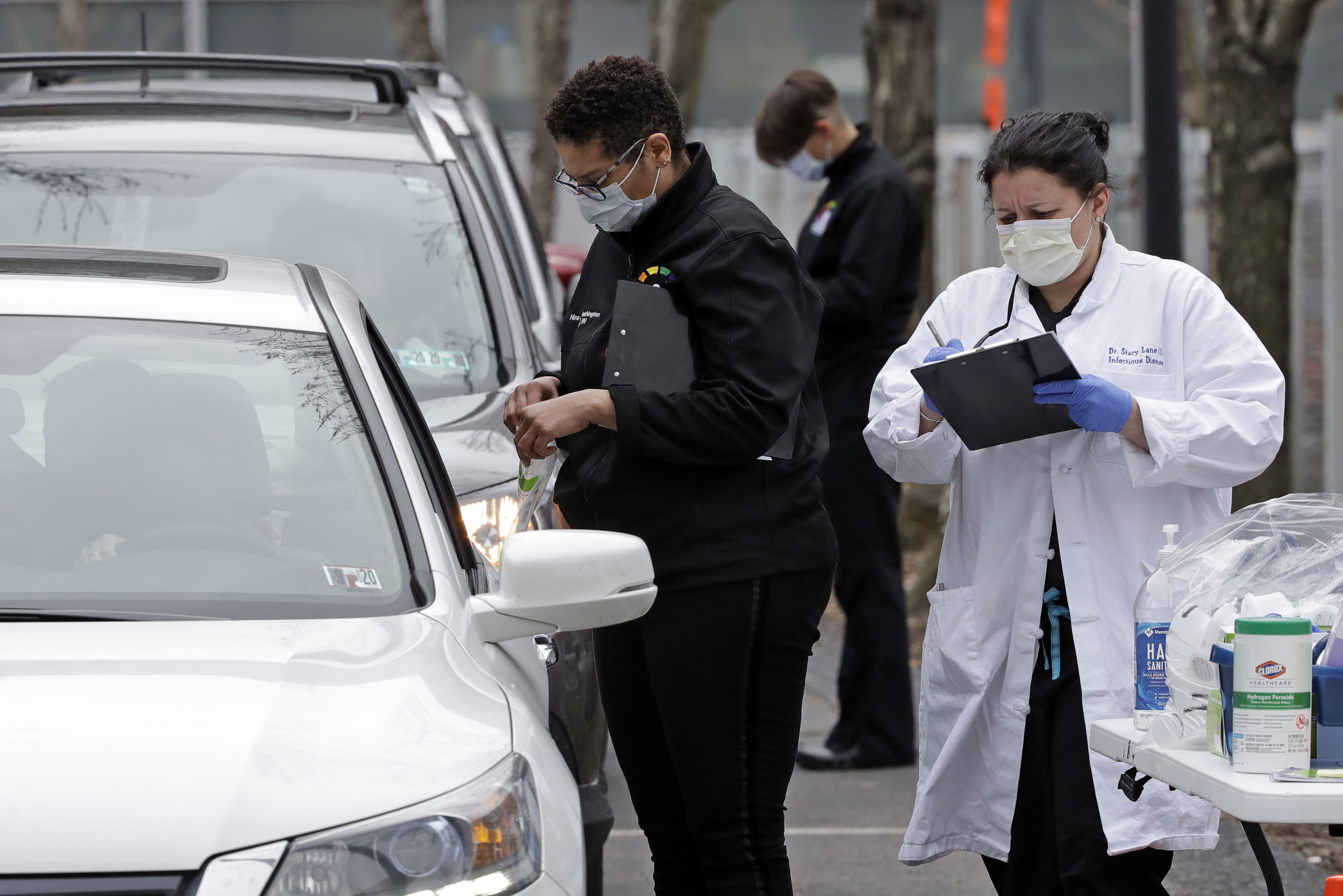 People in cars line up in Pittsburgh on March 16 for drive-by Covid-19 testing. The testing is done in partnership with Quest Diagnostics.