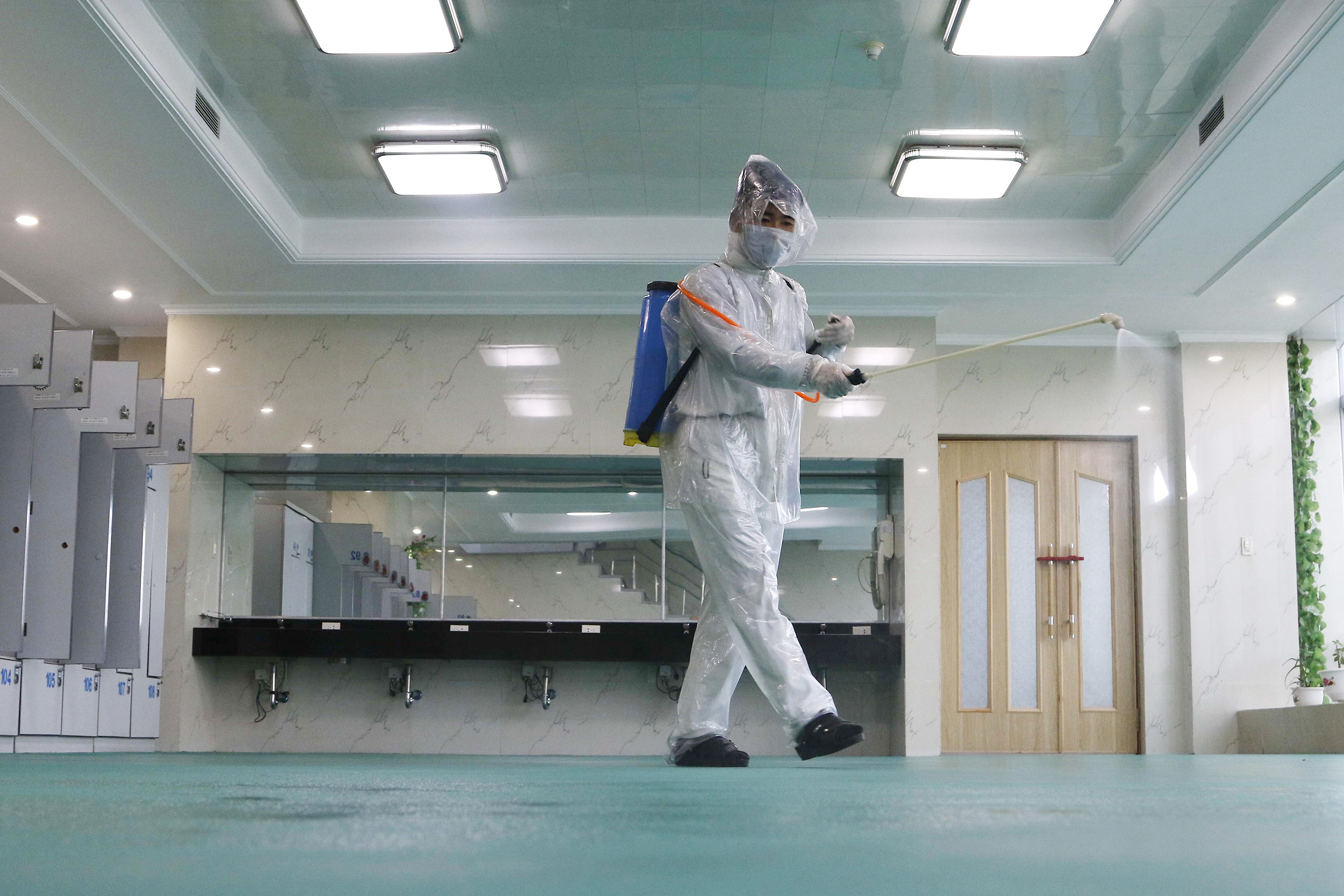 An employee disinfects the room to help curb the spread of the coronavirus at the Ryugyong Health Complex's public bath in Pyongyang, North Korea, on July 31.