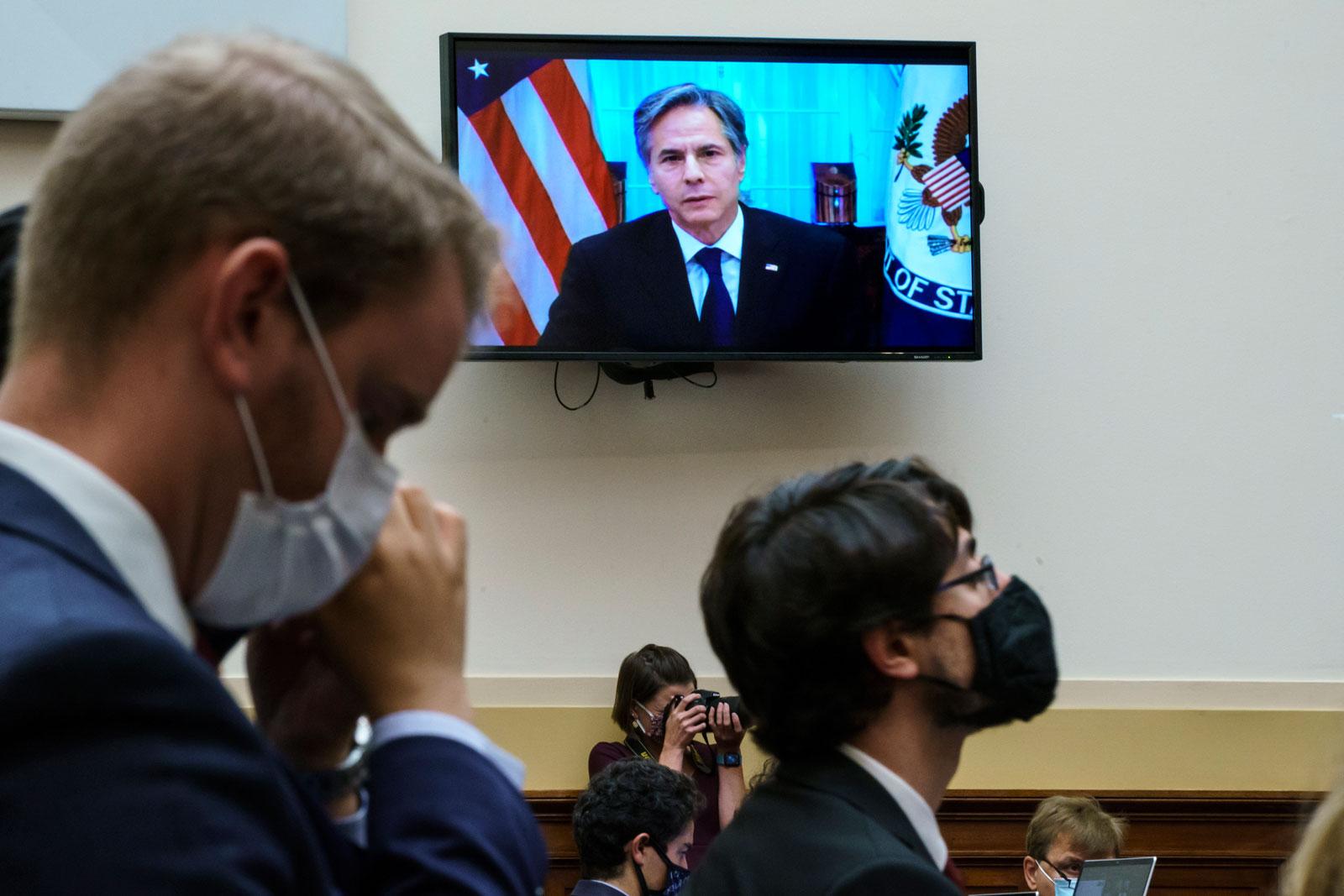 Secretary of State Antony Blinken appears remotely on a TV monitor on September 13.