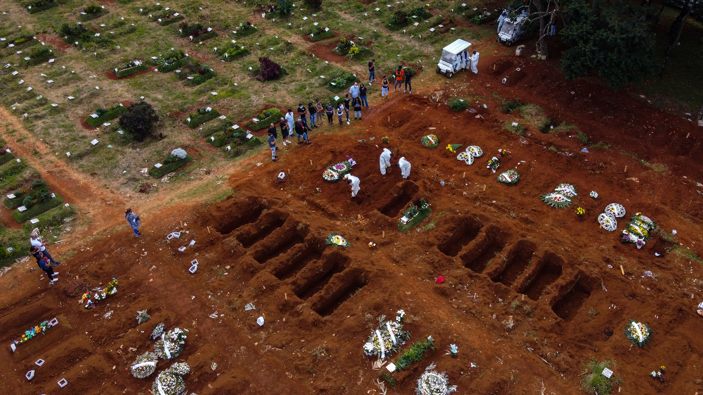 Open graves are seen at the Vila Formosa Cemetery in São Paulo, Brazil, on Friday. Vila Formosa, the biggest graveyard in Latin America, has seen its activity grow in the last few weeks due to the surge of deaths related to Covid-19.