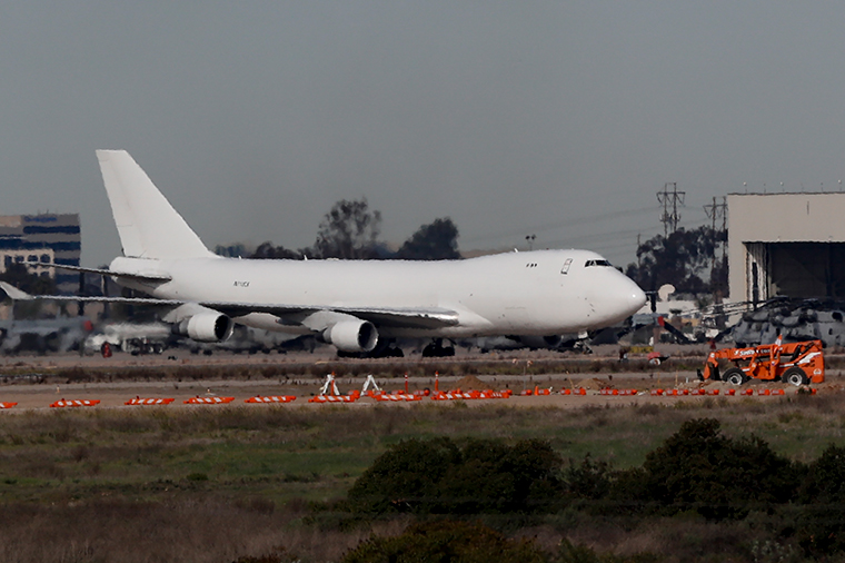 A plane carrying evacuees from the virus zone in China lands at Marine Corps Air Station Miramar Wednesday, February 5.