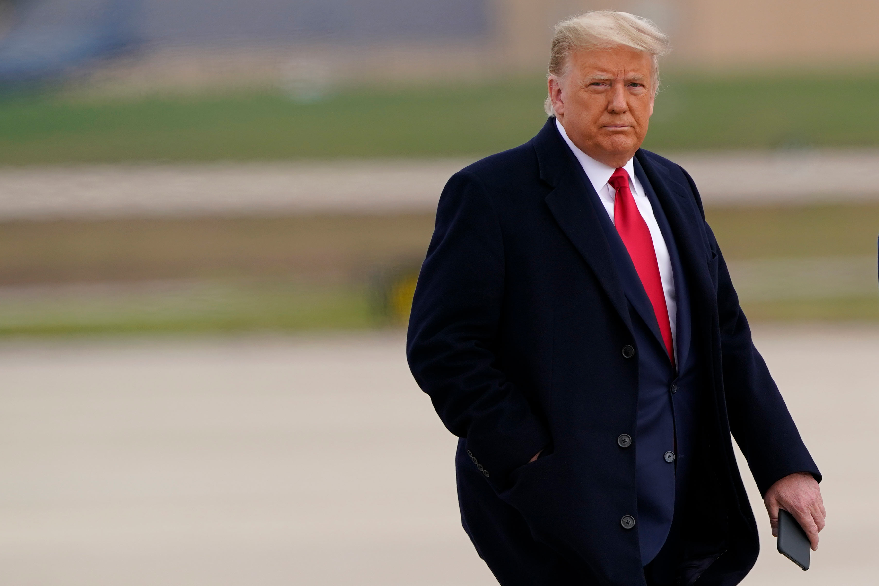 President Donald Trump walks towards Air Force One at Andrews Air Force Base, Maryland, on October 30.