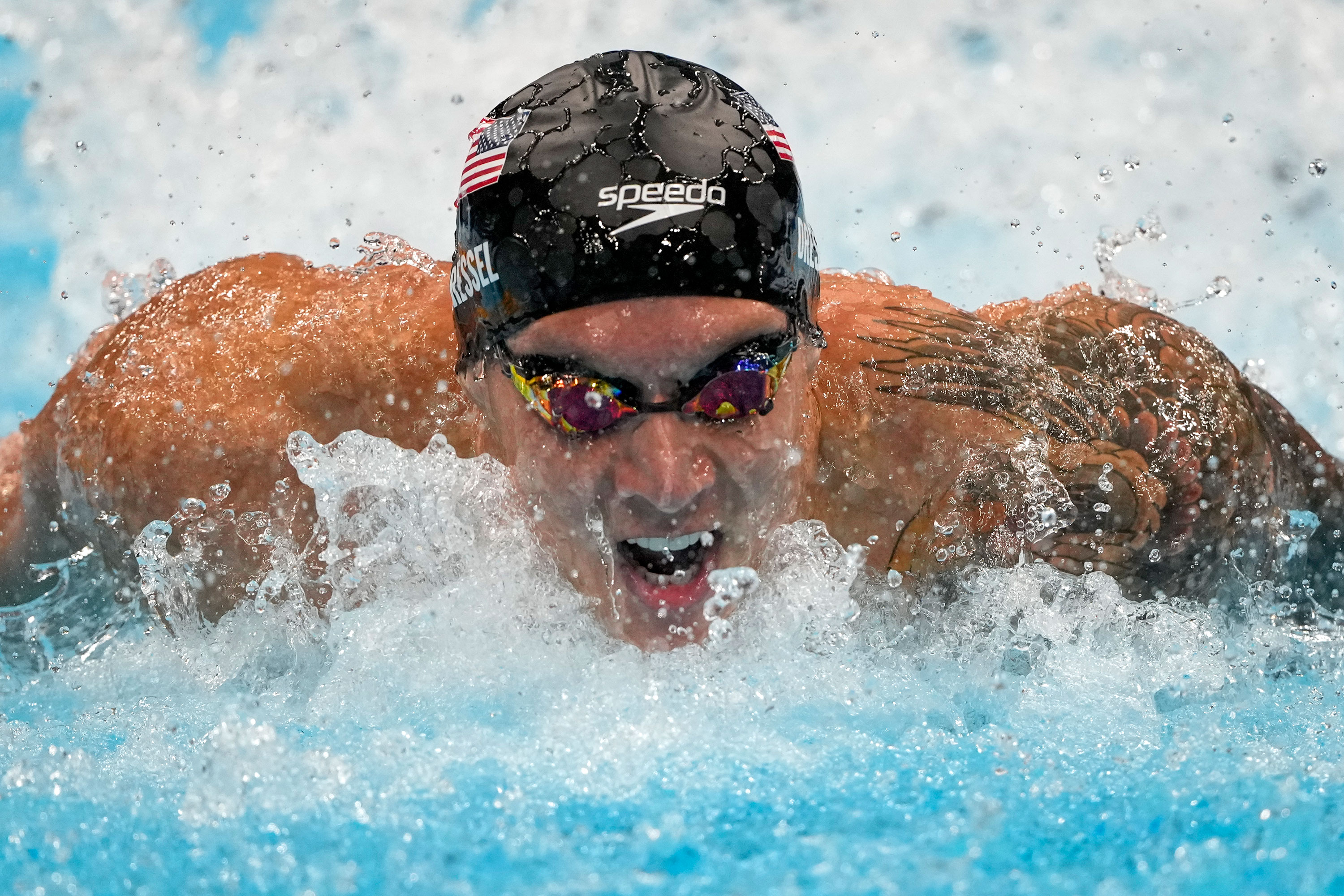 American Caeleb Dressel swims in the 100-meter butterfly final on July 31. Dressel took home gold in the event.