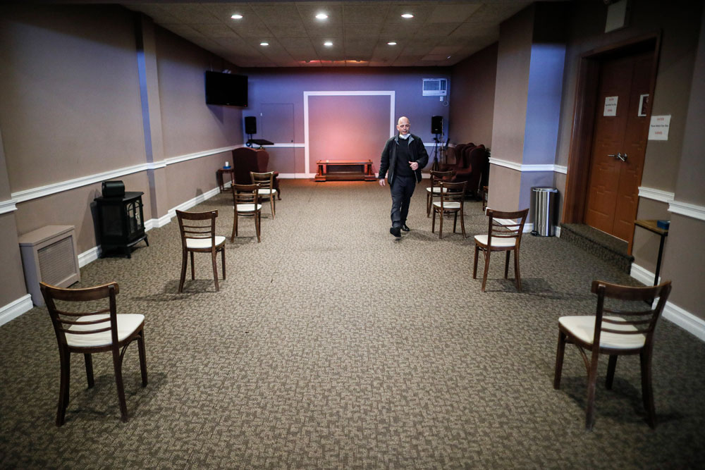 Marmo walks through a viewing room set up to respect social distancing on Thursday, April 2.