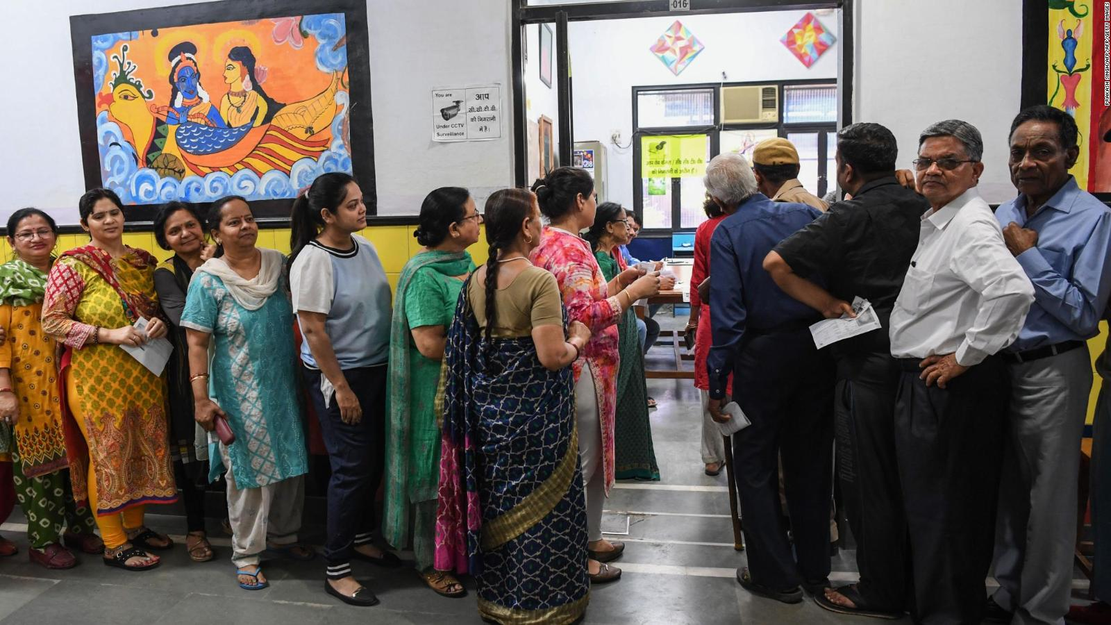 People line up to vote at a polling station during India's general election in Ghaziabad, Uttar Pradesh on April 11, 2019.