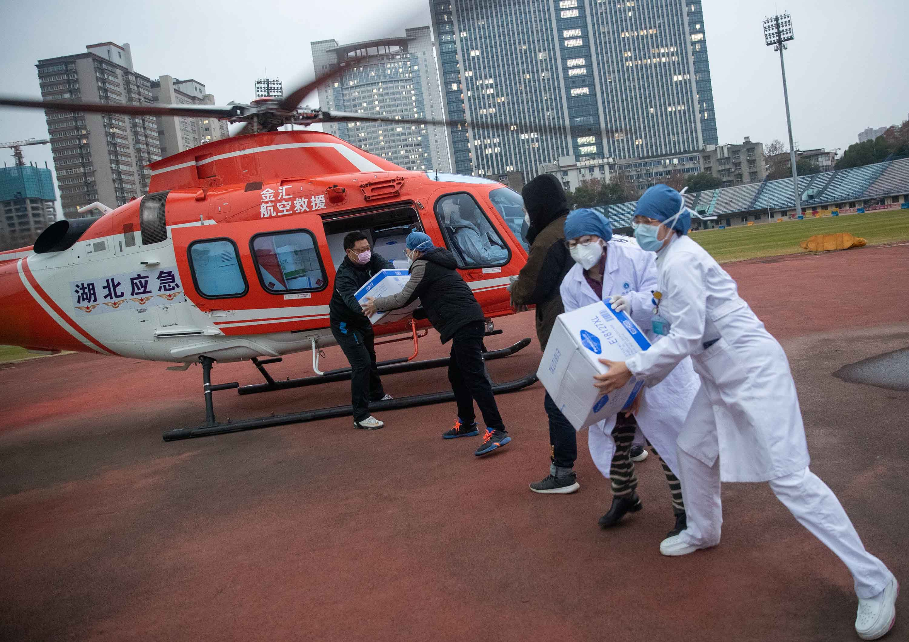 Medical staff unload supplies from a helicopter in Wuhan on February 1.