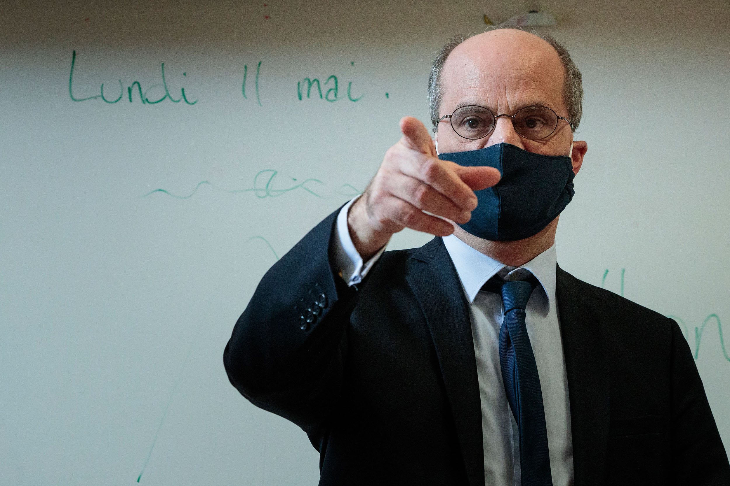 French Education and Youth Affairs Minister Jean-Michel Blanquer wears a mask during a school visit in Paris, France, on May 11.