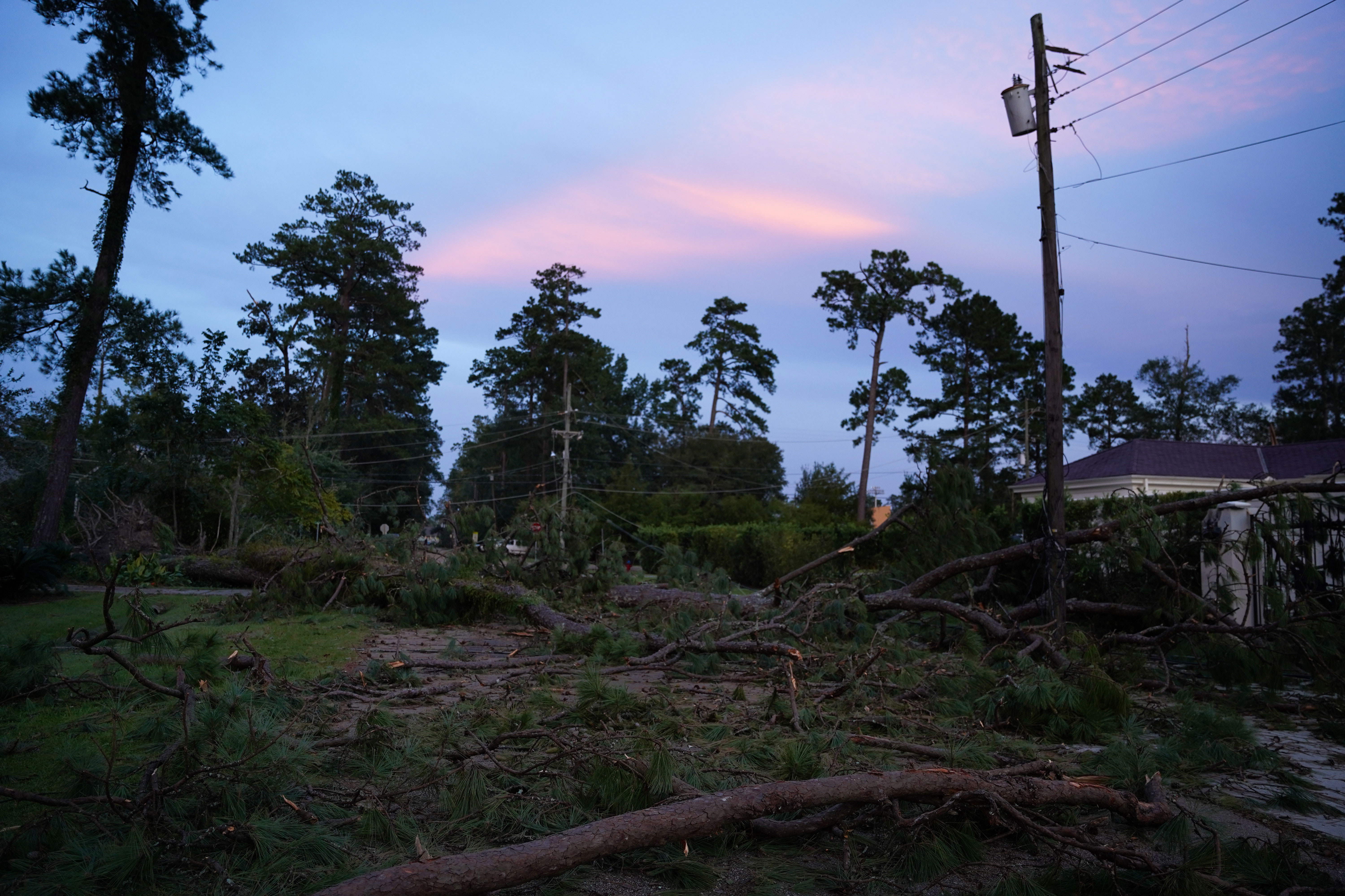A storm-damaged neighborhood in Covington, Louisiana, is pictured during sunset on August 31.