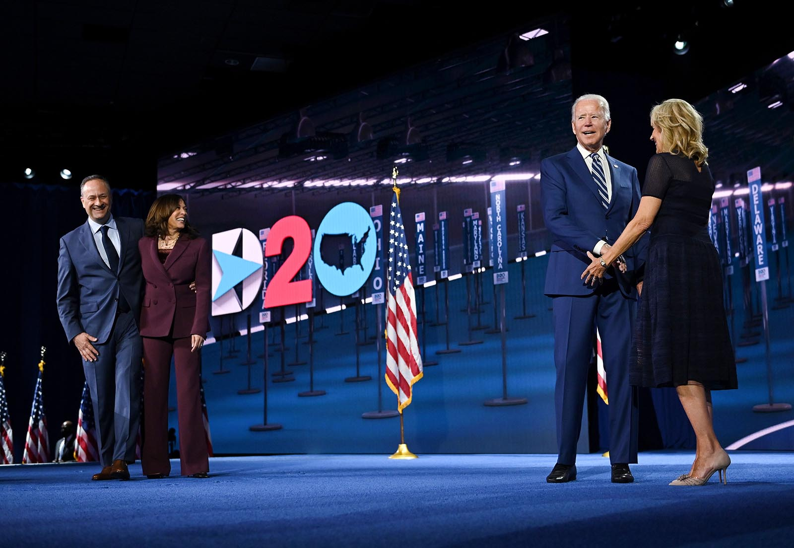 Senator from California and Democratic vice presidential nominee Kamala Harris and her husband Douglas Emhoff stand on stage socially distanced from former Vice President and Democratic presidential nominee Joe Biden and his wife former Second Lady of the United States Dr. Jill Biden at the end of the third day of the Democratic National Convention at the Chase Center in Wilmington, Delaware on August 19.