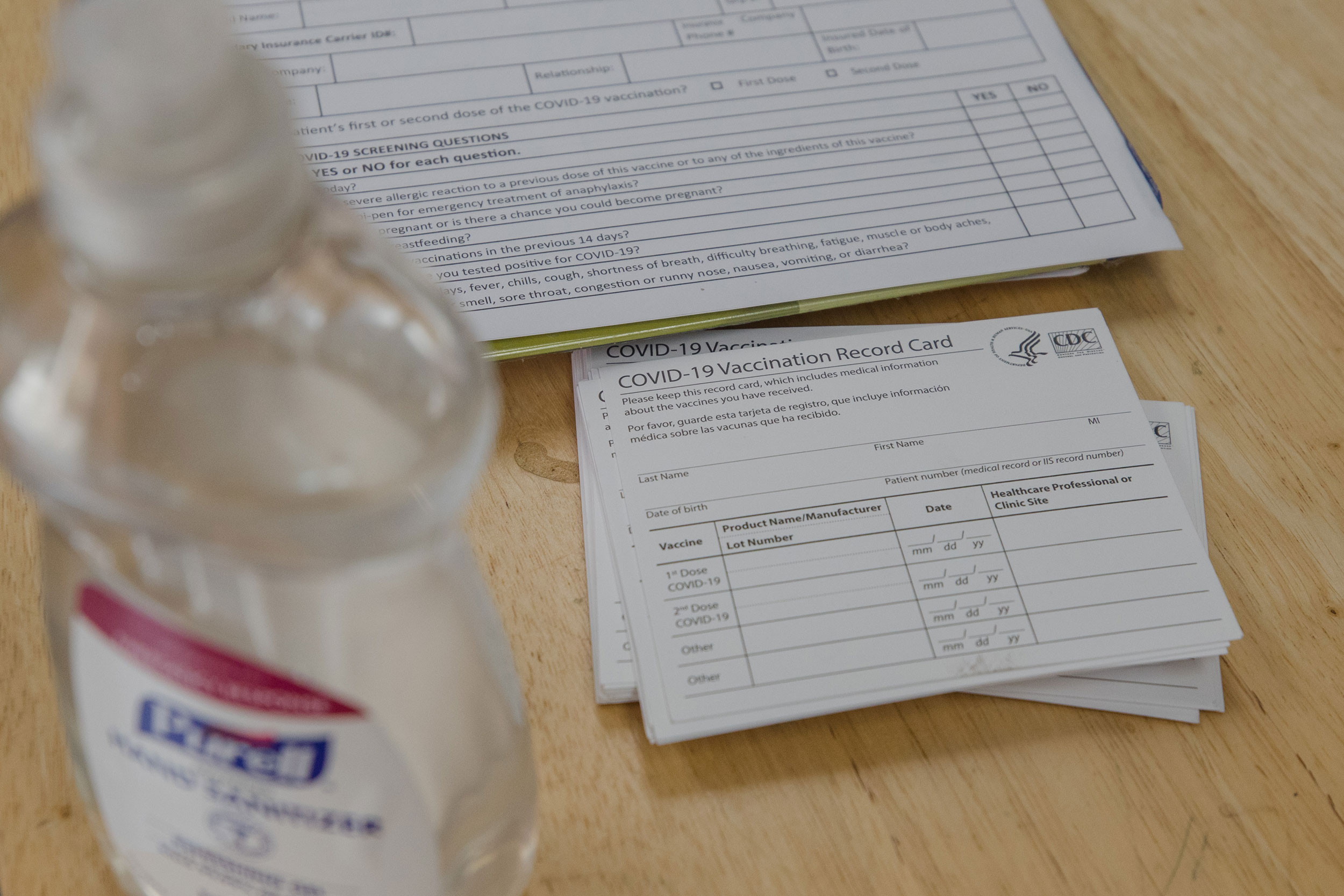 Blank vaccination cards sit on a table at a Family Heath Center mobile Covid-19 vaccination site in Santee, South Carolina, on Tuesday, July 13.