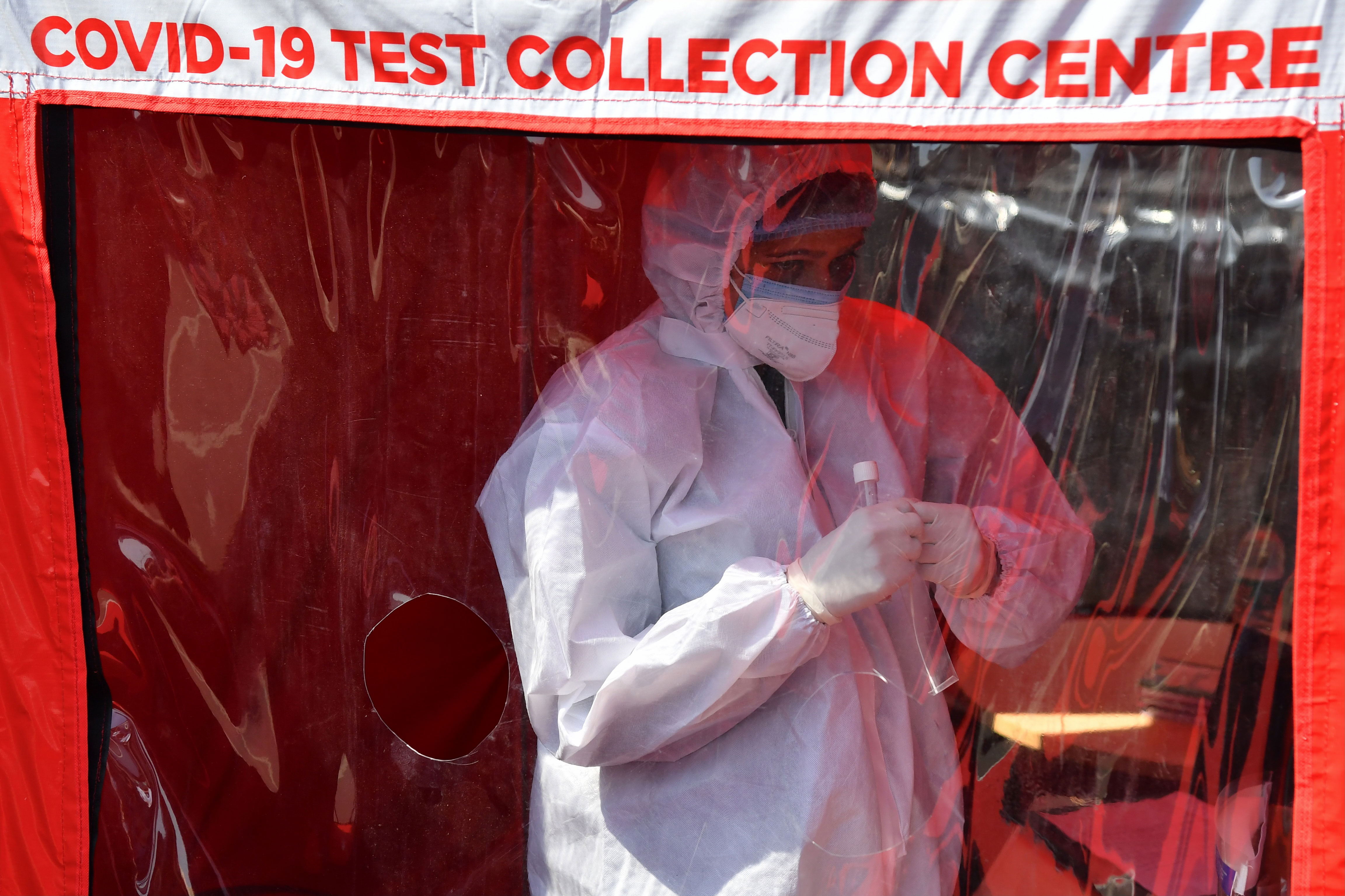 A health worker prepares to take swab samples at a mobile Covid-19 testing center in Mumbai, India, on February 11.