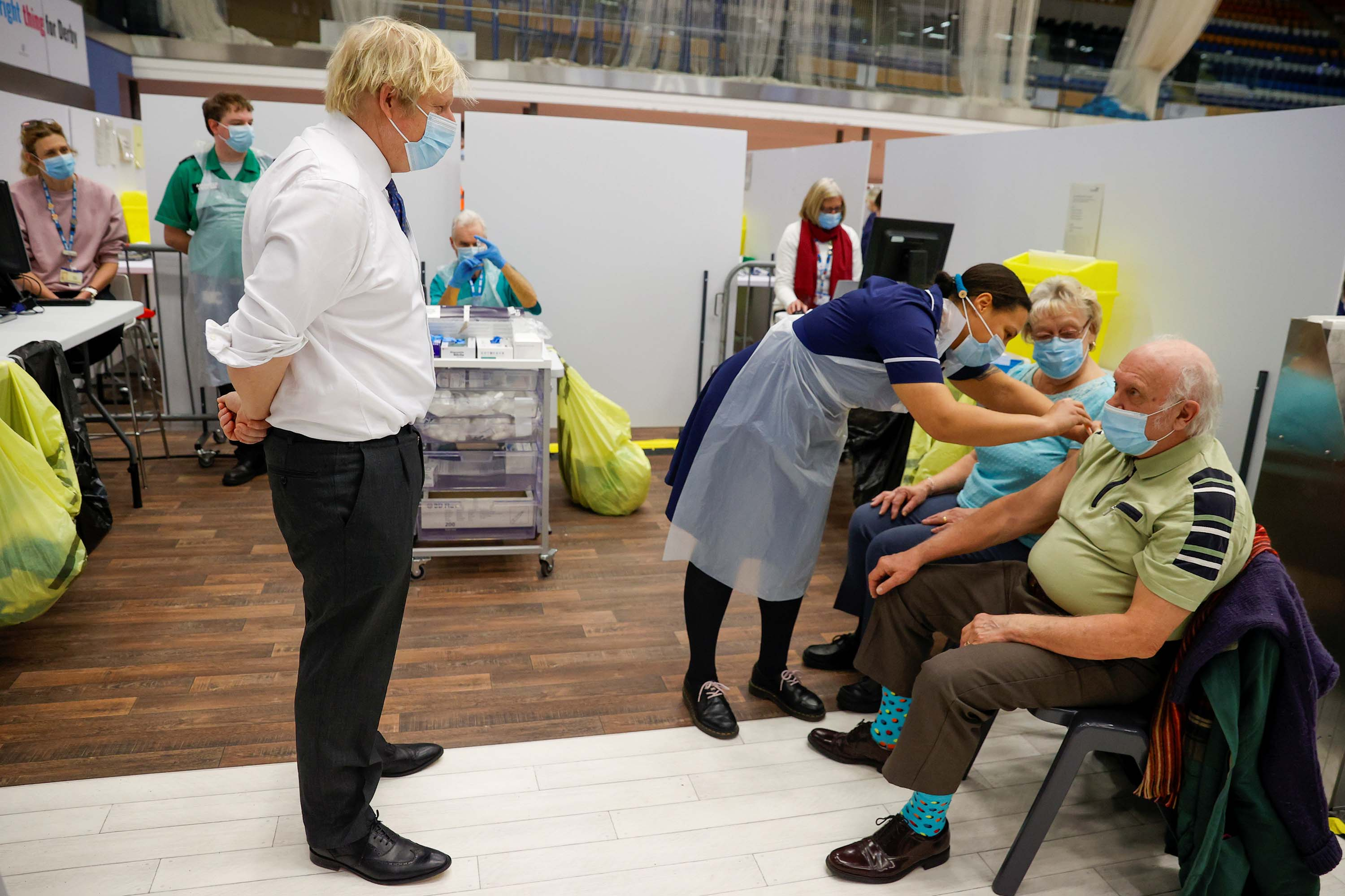 British Prime Minister Boris Johnson visits a vaccination center at the Derby Arena velodrome on February 8, in Derby, England.