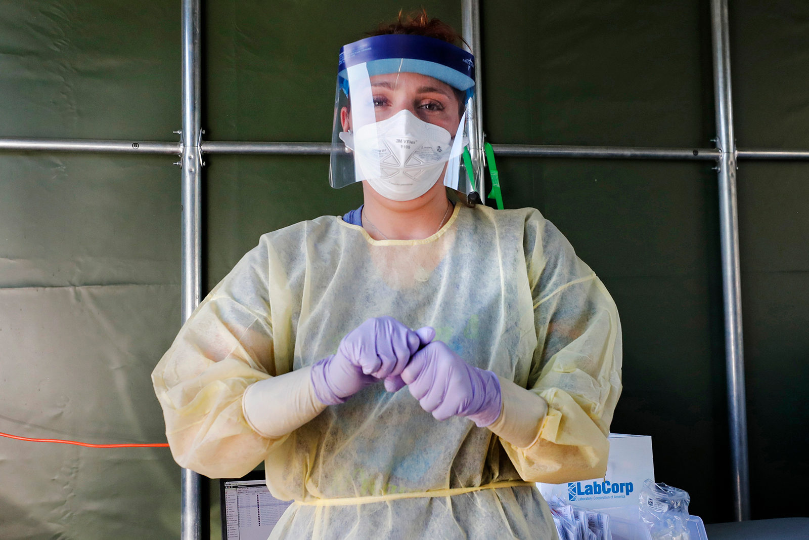 A medical worker prepares to administer a Covid-19 virus test at a drive-thru care testing site at the Derry Medical Center on Wednesday, June 17, in Derry, New Hampshire.
