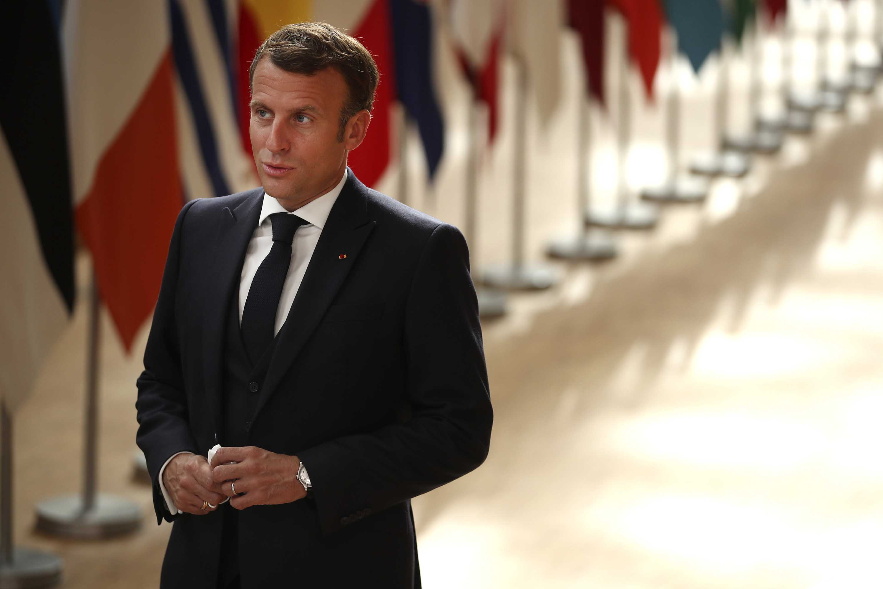 French President Emmanuel Macron makes a statement as he arrives for an EU summit at the European Council building in Brussels, Belgium, on July 19.