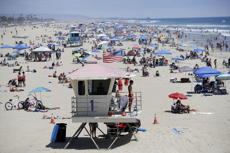 A lifeguard keeps watch in Huntington Beach, California, on June 27.