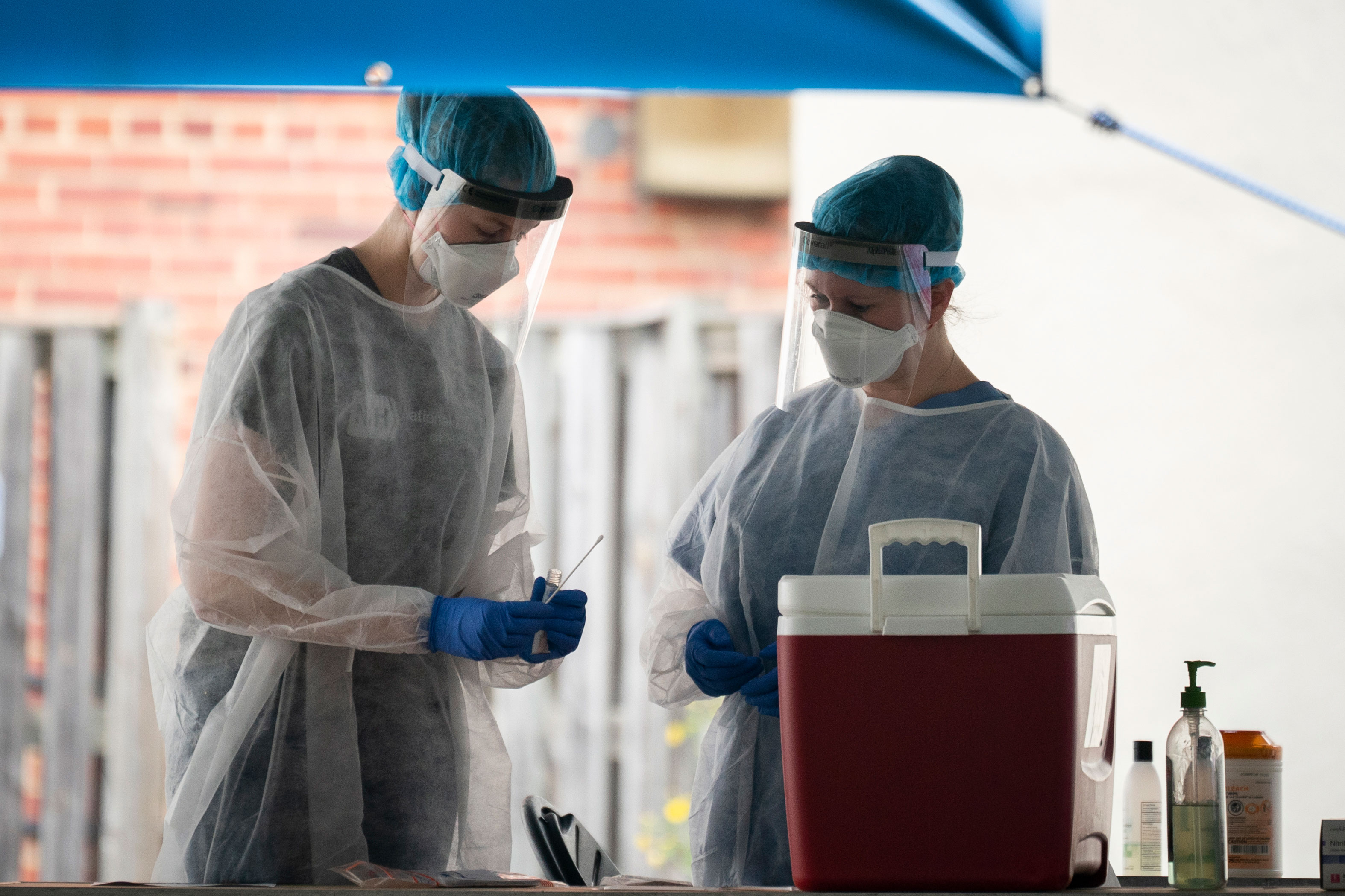 Medical professionals prepare to administer a coronavirus test at a drive-thru testing site run by George Washington University Hospital on May 26 in Washington.