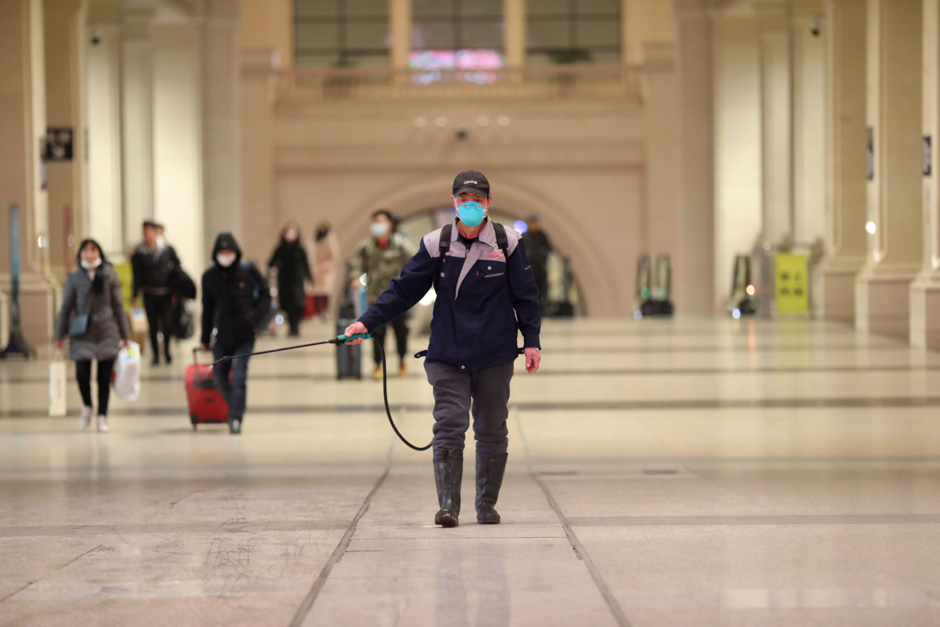 A worker disinfects a railway station in Wuhan, China, on Wednesday, January 22.
