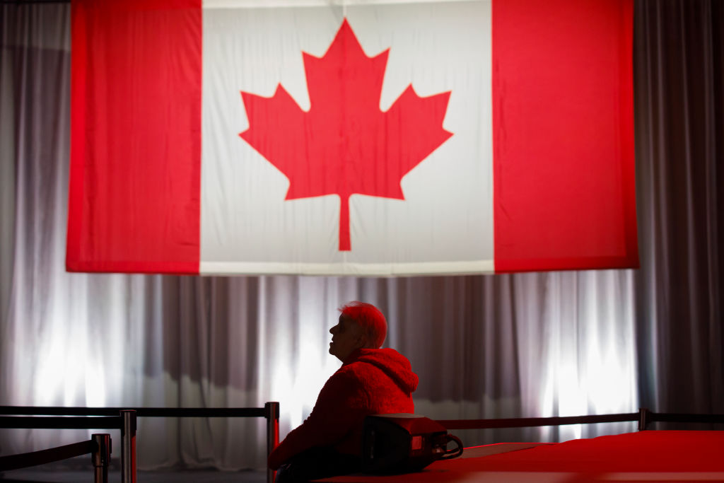 A supporter watches early election results roll in at Canadian Prime Minister Justin Trudeau's election night headquarters in Montreal.
