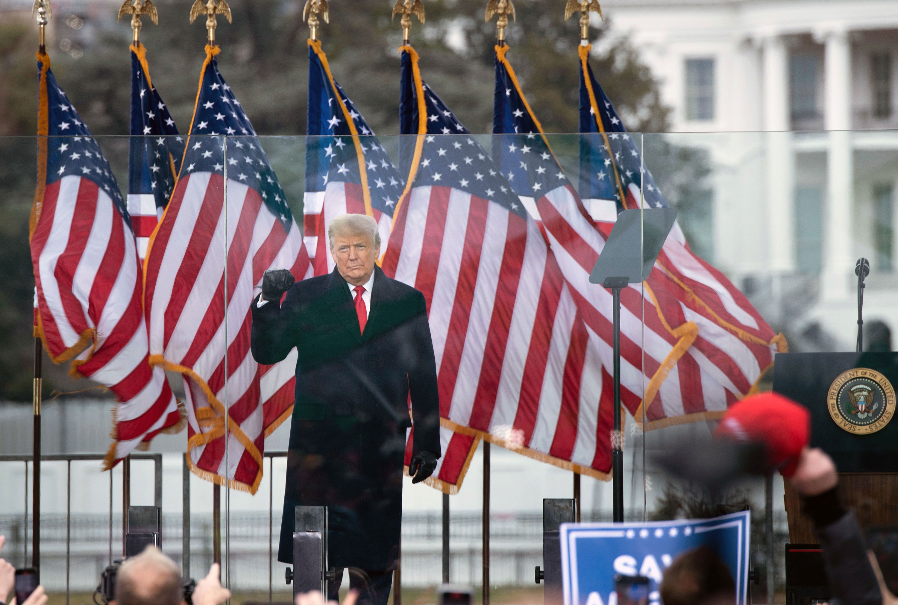 President Donald Trump gestures to supporters from The Ellipse near the White House on January 6.