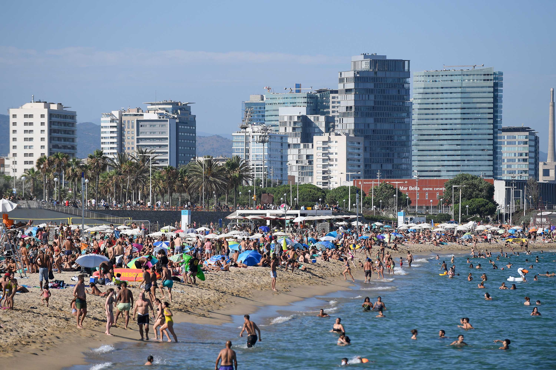 People visit Bogatell beach in Barcelona, Spain, on July 19.