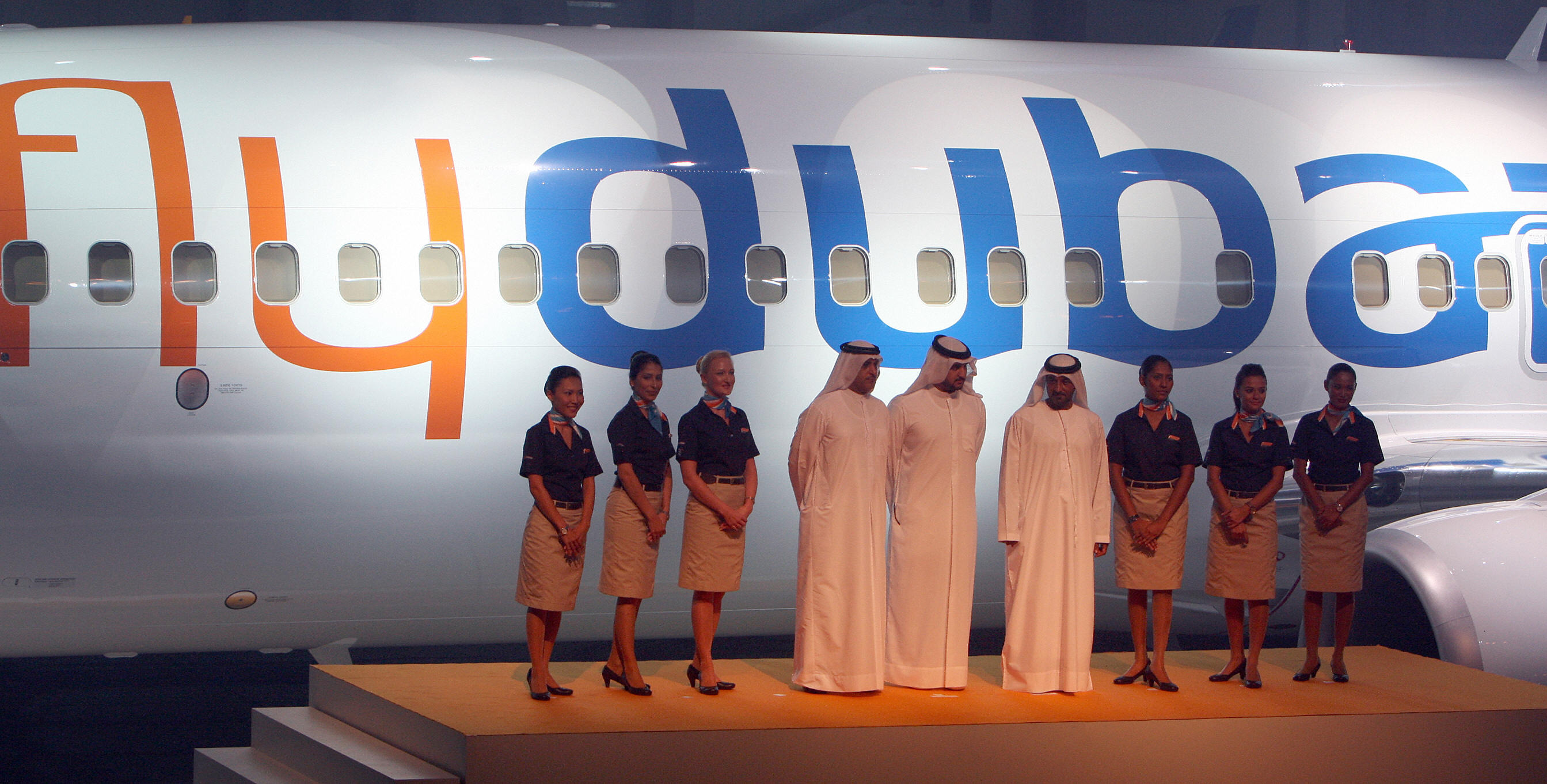 Airline staff pose in front of a flydubai Boeing 737-800 Next Generation aircraft during a ceremony in the Gulf emirate ahead of the airline's debut flight to Beirut in 2009.