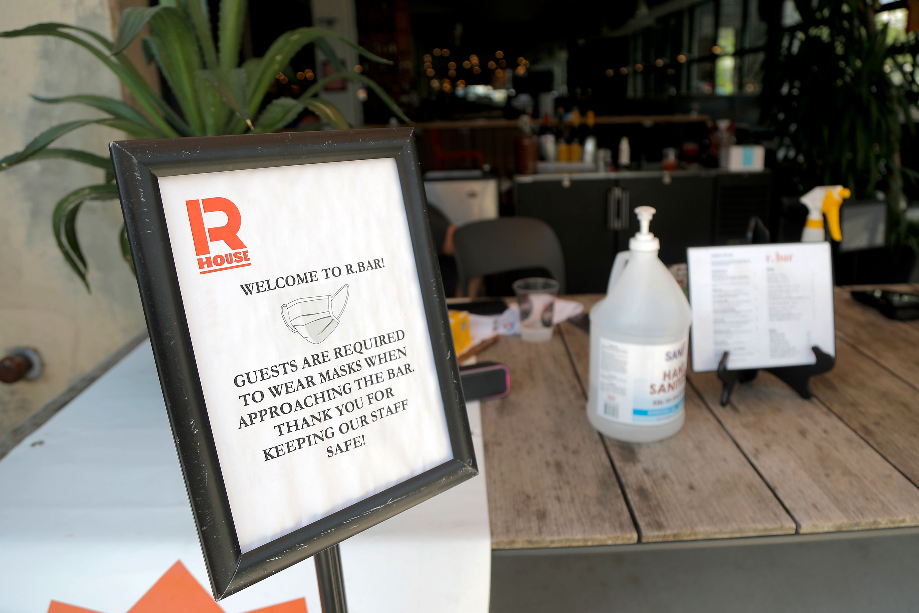 A sign is displayed near the entrance of a food hall in Baltimore on July 15.
