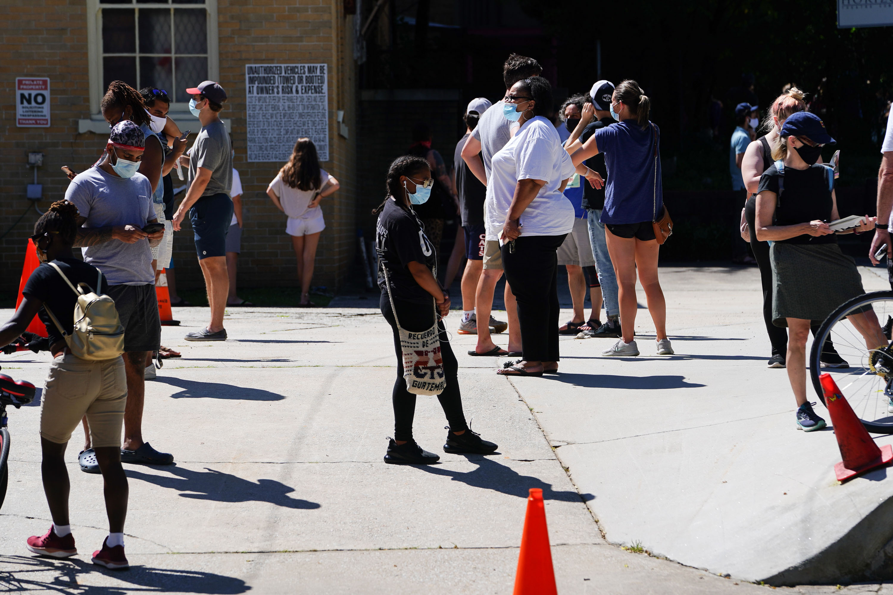 People wait in line to get tested for Covid-19 at a testing site in Atlanta on July 11.