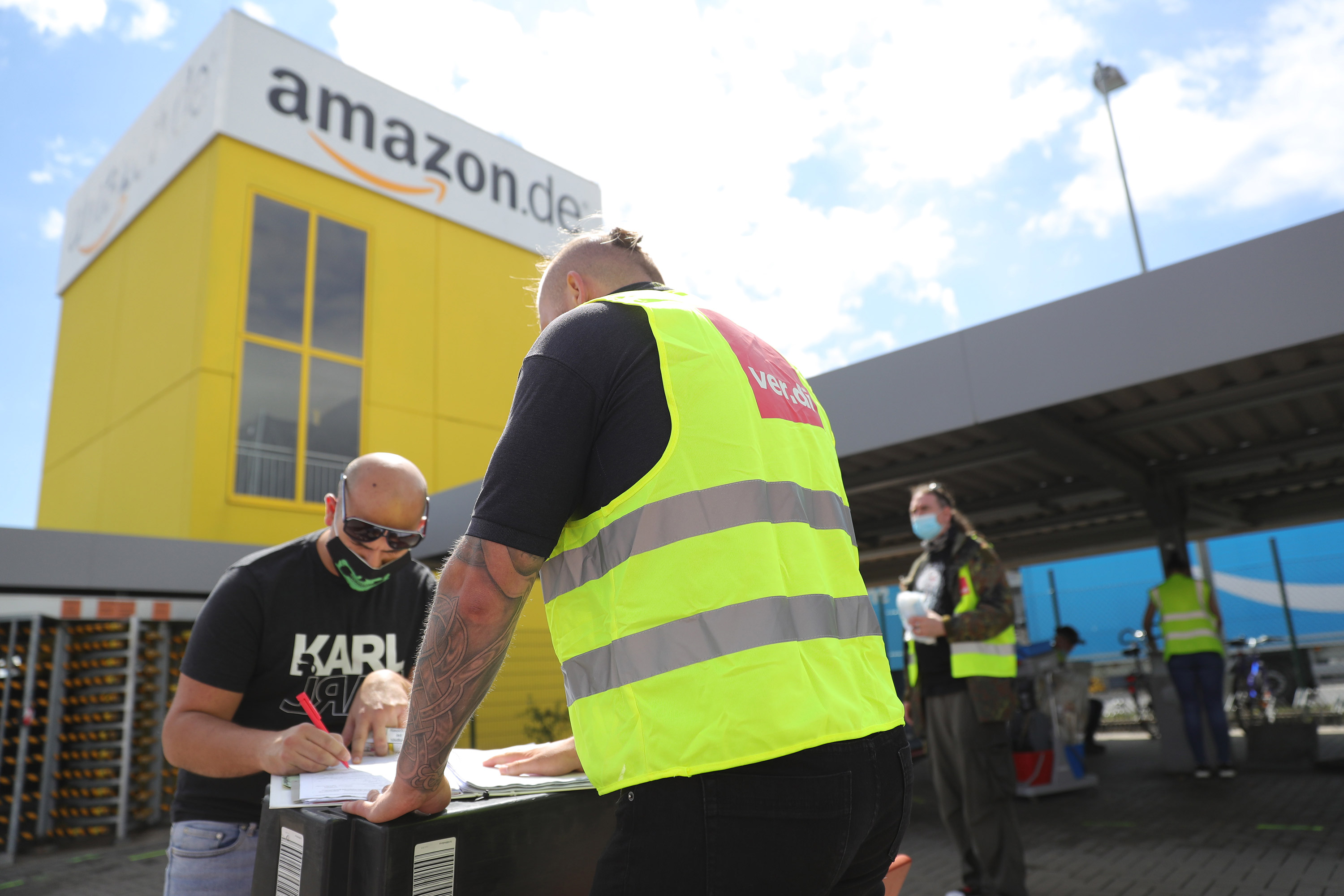Striking Amazon employees stand outside an Amazon warehouse during the coronavirus pandemic on June 29 in Kobern-Gondorf near Koblenz, Germany.