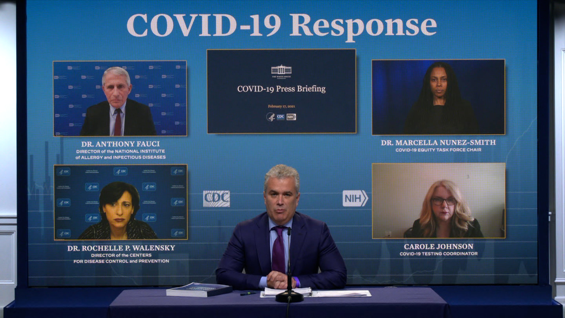 White House Covid-19 Response Coordinator JeffZients, center, speaks during a news briefing on February 17.
