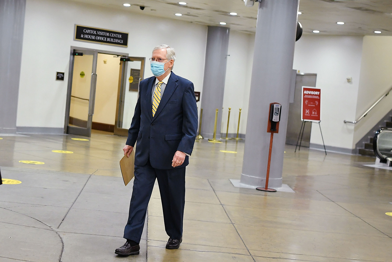 Senate Majority Leader Mitch McConnell, R-KY, waits for the subway to the Hart Senate Office building, at the US Capitol in Washington, DC on August 5.