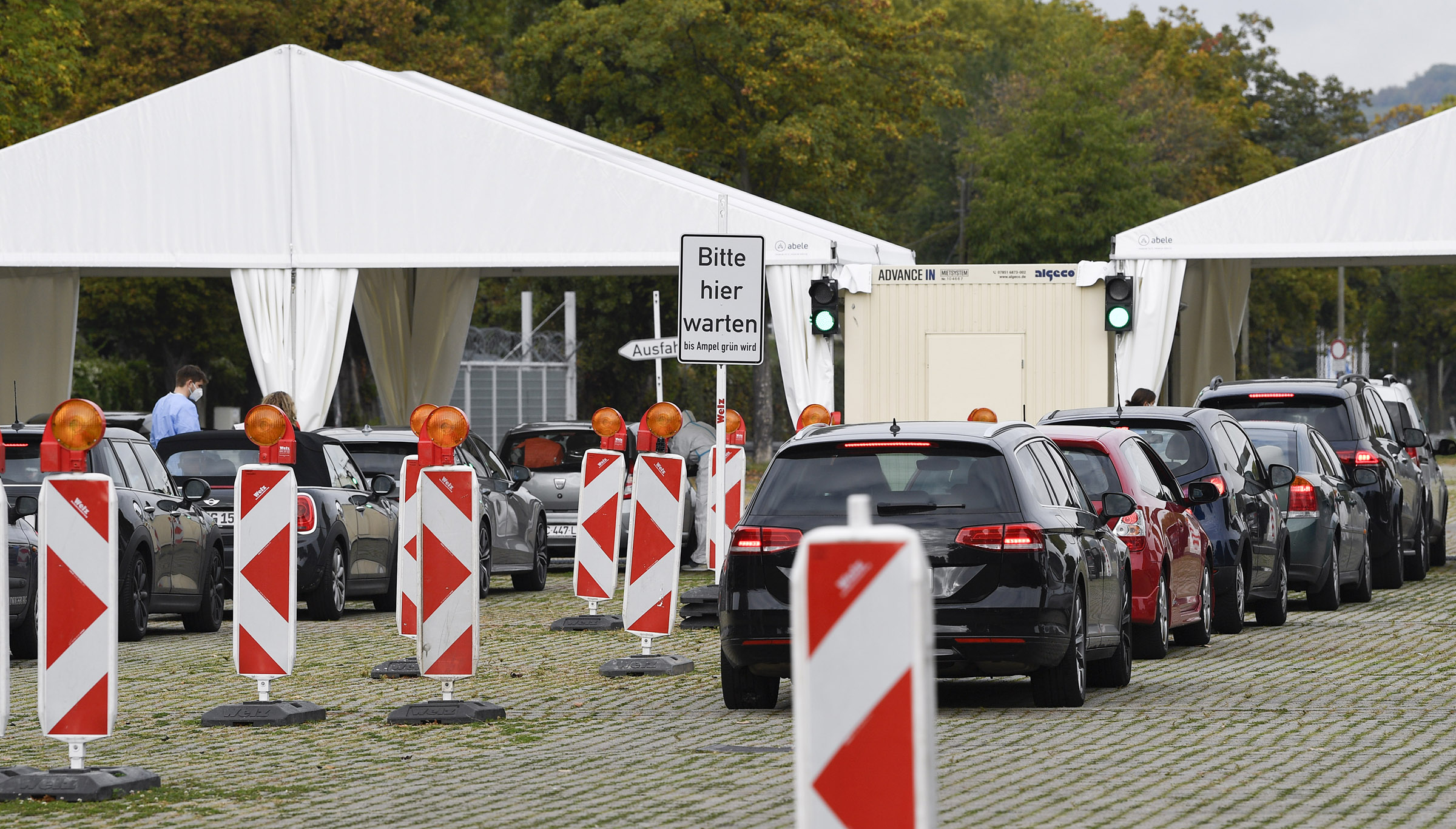 Cars line up at the coronavirus testing drive-in station at Cannstatter Wasen in Stuttgart, Germany, on October 13, amid the new coronavirus COVID-19 pandemic.