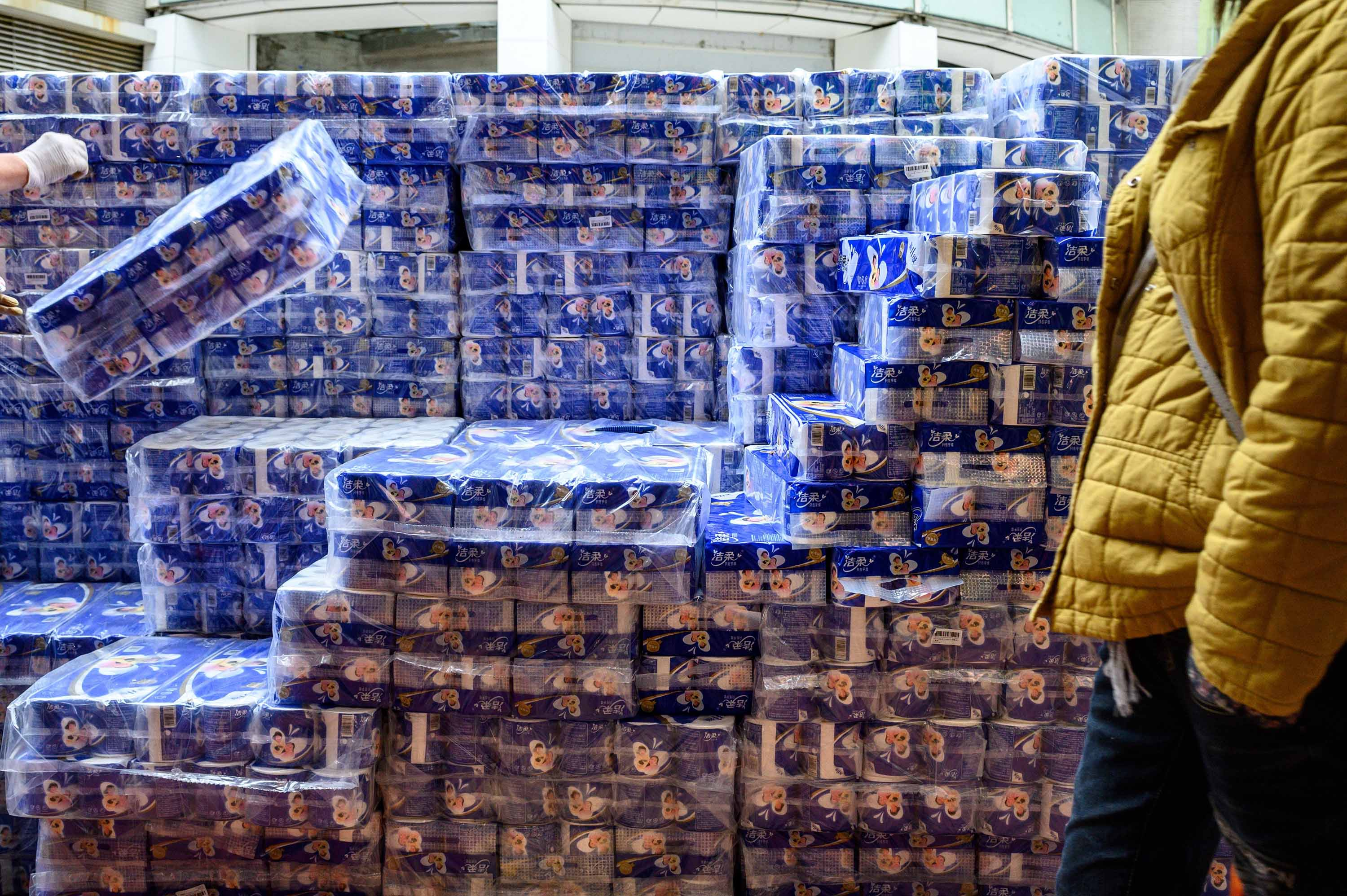Toilet paper is stacked for sale outside a store in Hong Kong on February 8.