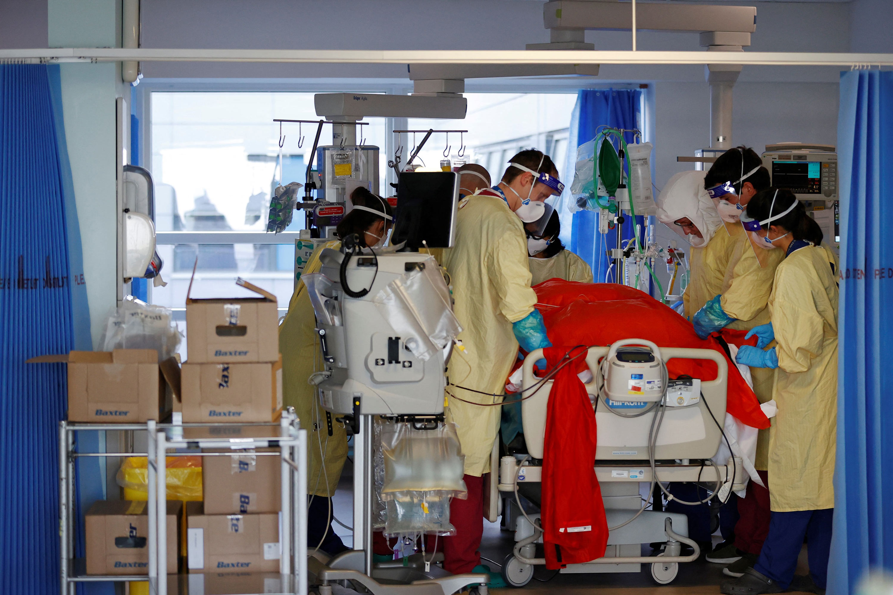Medical workers help prone a Covid-19 patient in the intensive care unit at Queen Alexandra Hospital in Portsmouth, England, on March 23.