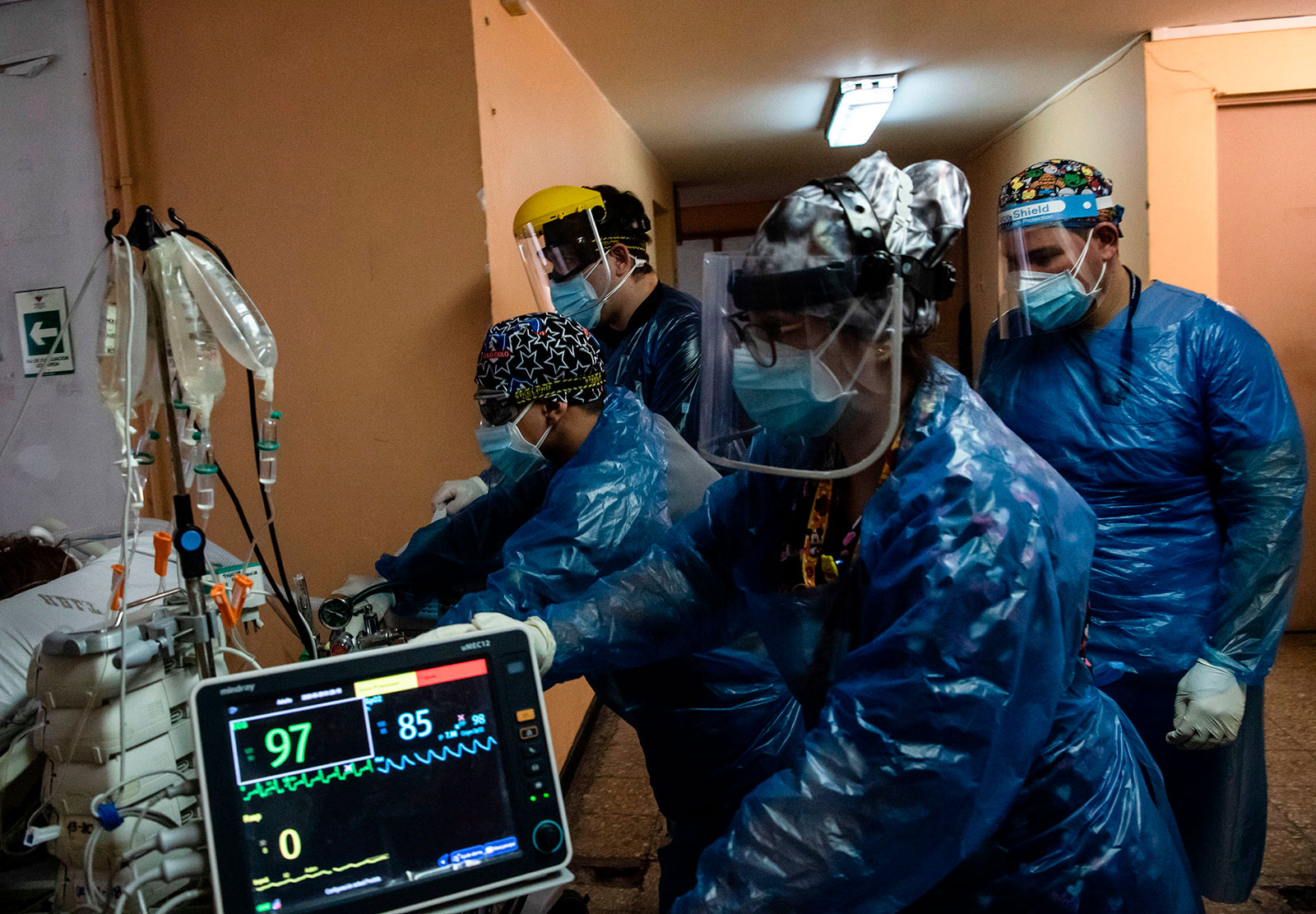 Nurses transfer a Covid-19 patient to the Critical Patients Unit at Barros Luco Hospital in Santiago, Chile, on June 24.
